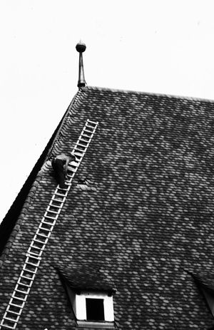 1977 Architecture Austria Building Exterior Built Structure Day Innsbruck Low Angle View Man At Work Outdoors Roof Staircase Tiled Roof  Top Of Building