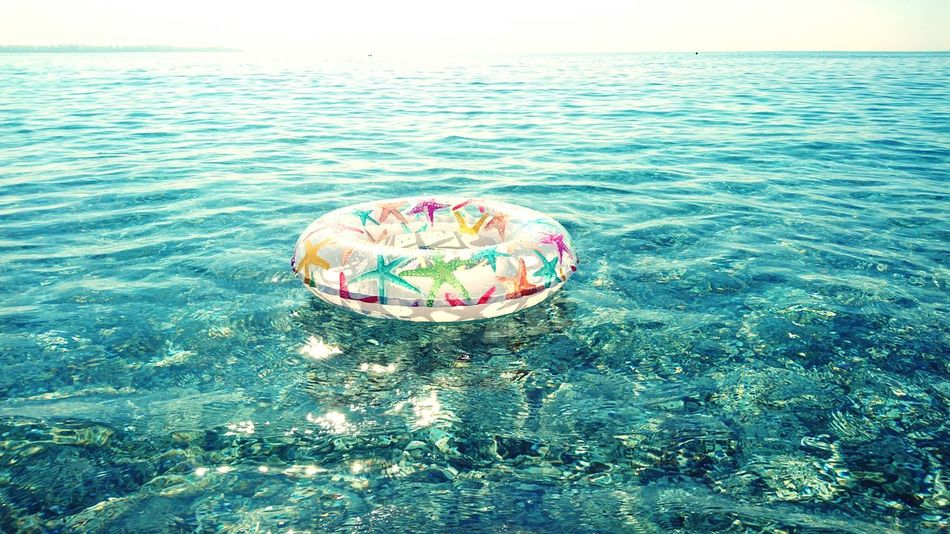Sea Nature Multi Colored Tranquility Outdoors Horizon Over Water Beauty In Nature Scenics Sky Freshness Water Beach Day Tranquil Scene Taking Photos Naturelovers EyeEm Focused EyeEm Best Shots Ocean Ring Flotation Bagel Lifering Sea And Sky EyeEmNewHere Adapted To The City