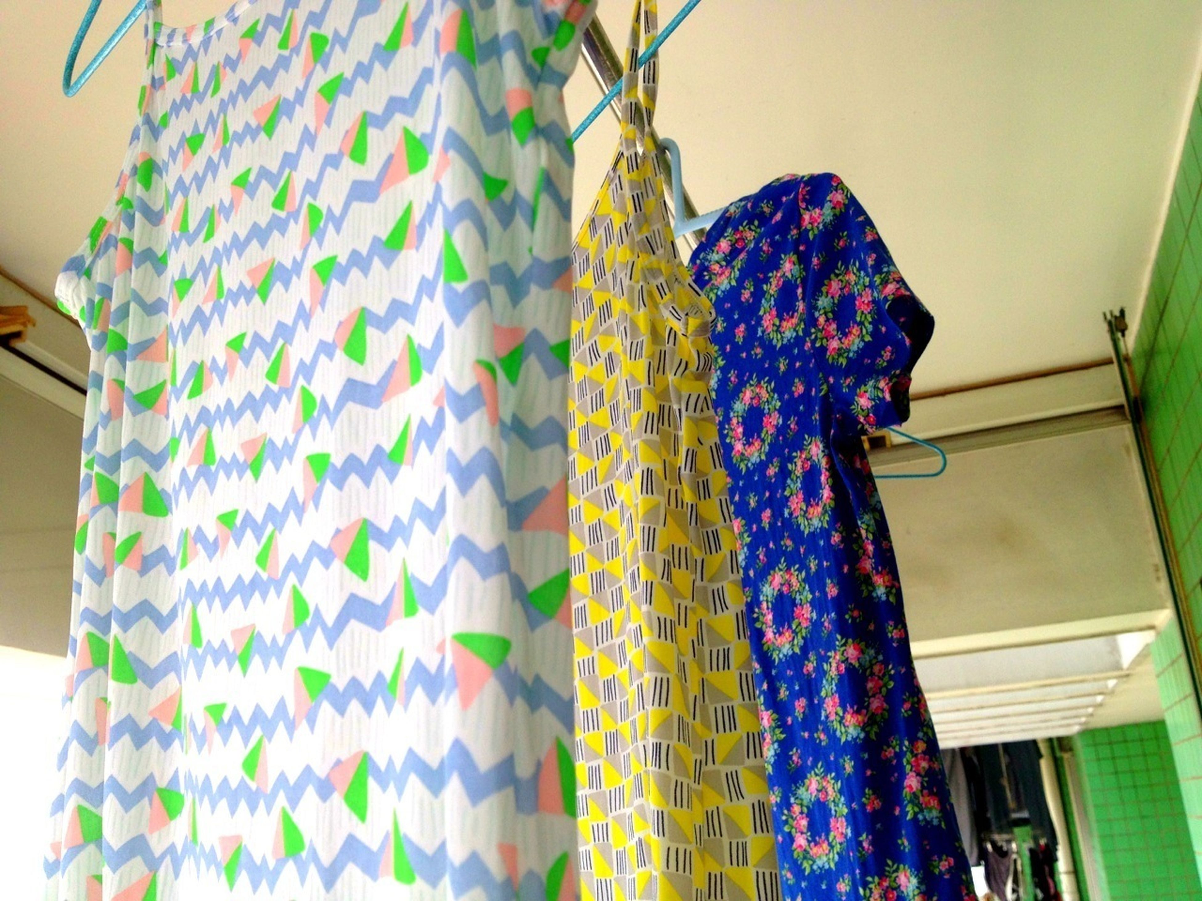 indoors, hanging, multi colored, wall - building feature, decoration, home interior, low angle view, textile, pattern, fabric, curtain, art and craft, creativity, no people, art, clothing, floral pattern, architecture, design, variation