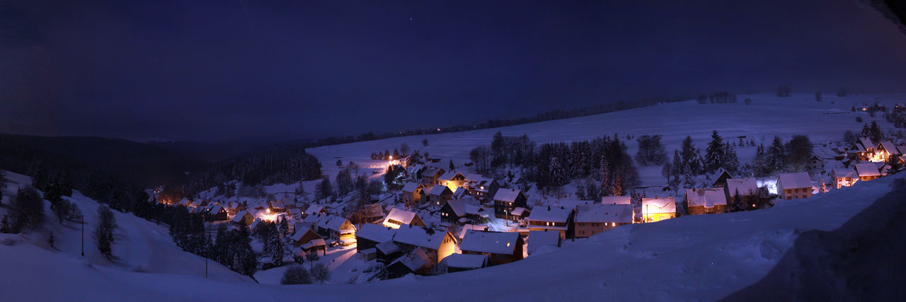 night, illuminated, winter, dusk, snow, built structure, house, outdoors, architecture, building exterior, high angle view, no people, sky, cold temperature, mountain, nature, tree