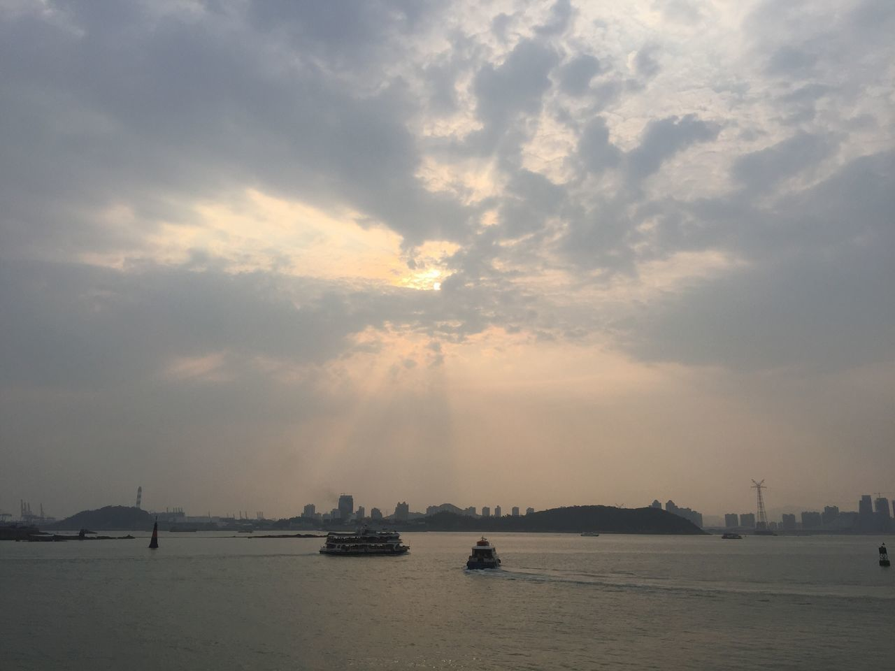 sky, water, cloud - sky, nautical vessel, sea, waterfront, city, sunset, skyscraper, nature, no people, cityscape, architecture, outdoors, building exterior, scenics, beauty in nature, built structure, storm cloud, sailing, urban skyline, day