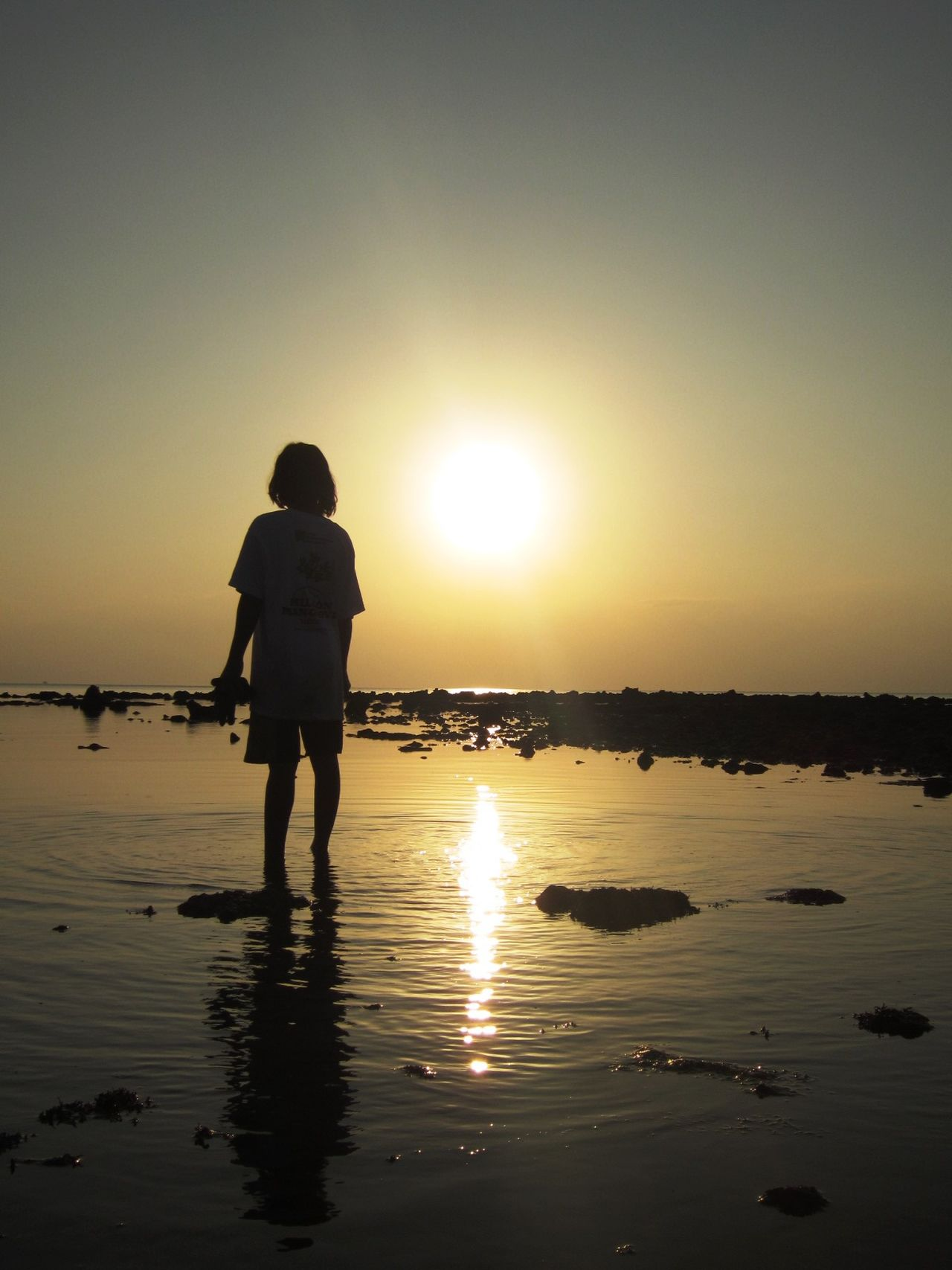 girl waiting for the sunset Beauty In Nature Childhood Sea Serenity Silhouette Sunset Tranquility Waiting EyeEmNewHere