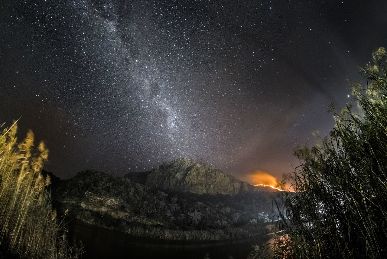 stars are burning, mountain on fire Astronomy Constellation Galaxy Landscape Milky Way Mountain Nature Night No People Outdoors Scenics Sky Space Space And Astronomy Star - Space Star Field Star Trail Stars Tranquil Scene Tranquility