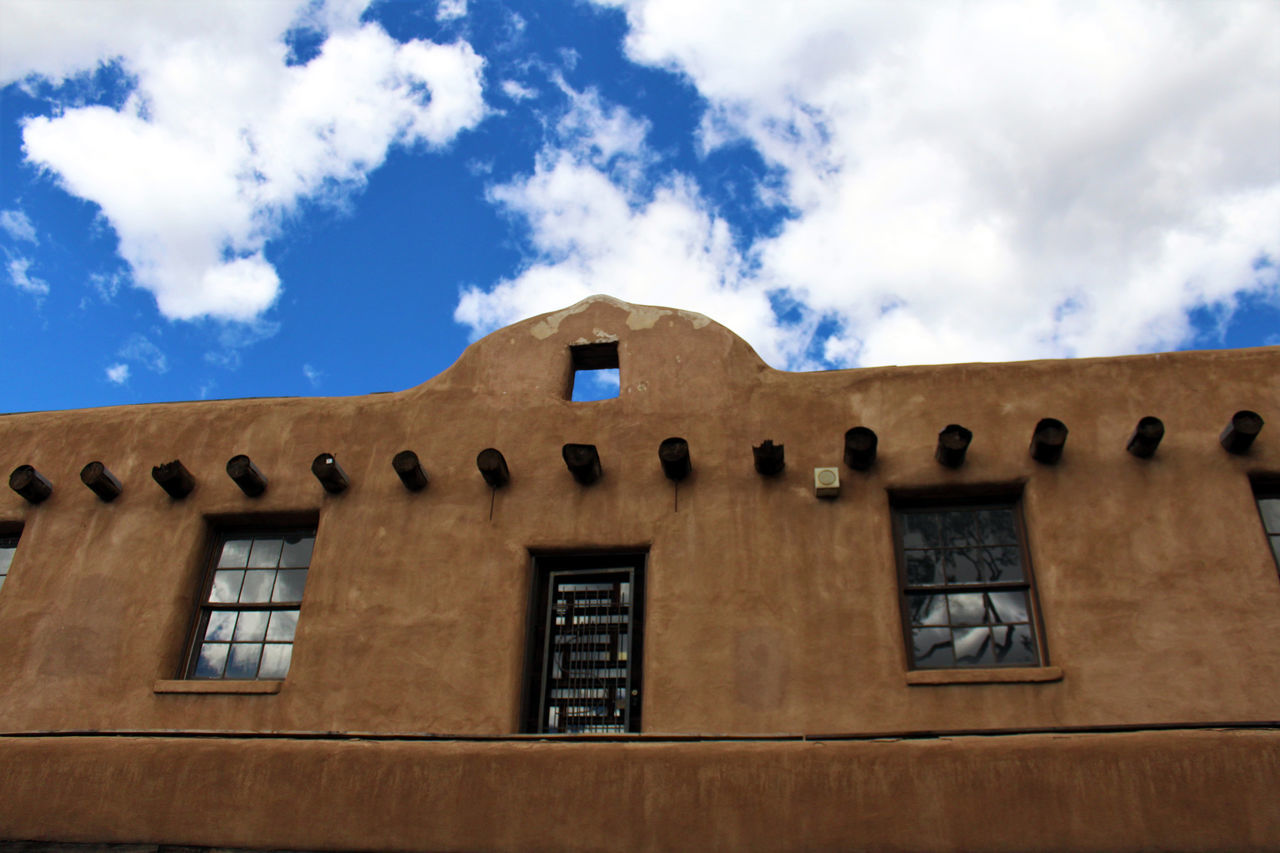 Adobe facade, Taos Plaza. Adobe Architecture Blue Sky Building Clouds Downtown Façade Façade Historic Historical Building Low Angle View New Mexico Plaza Pueblo Style Southwest  Southwestern Taos Miles Away