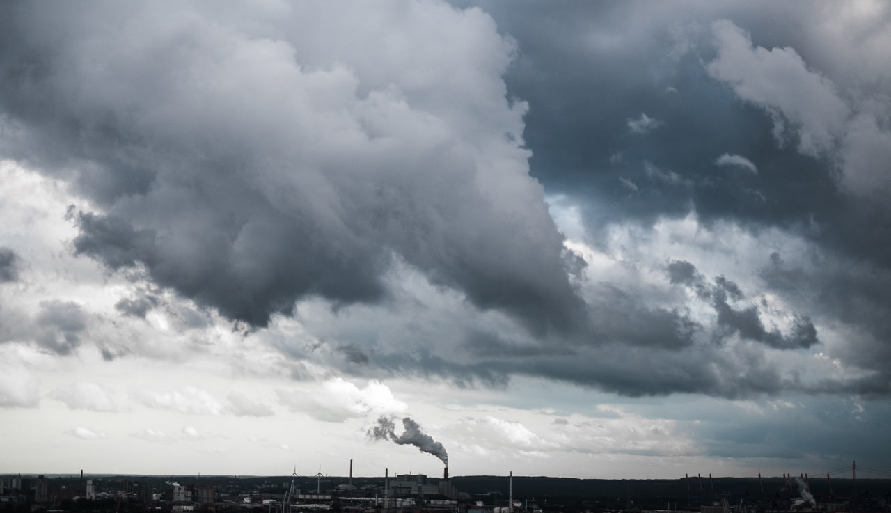 Smoking in the rain. (Industrial port of Hamburg, Germany). 35mm City Cloud - Sky Clouds Day Dramatic Sky Epic Fujifilm Fujinon Germany Hafen Hamburg Harbor Horizon Industrial Landscapes Industrial Photography No People Outdoors Panorma Sky Skyline Smoke Storm Storm Cloud X-T10
