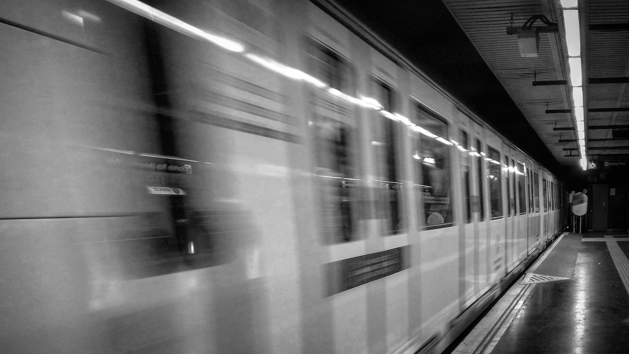blurred motion, motion, train - vehicle, transportation, public transportation, speed, passenger train, mode of transport, rail transportation, railroad station platform, railroad station, long exposure, travel, subway train, illuminated, indoors, commuter train, no people, day