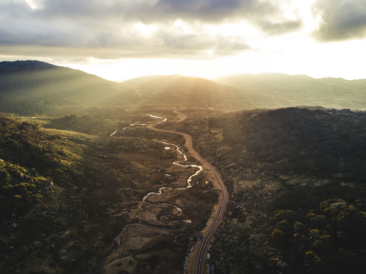 @itchban / www.itchban.com Aerial View Beauty In Nature Cloud - Sky Day Landscape Light Rays Mountain Mountain Range Mountain Road Mountains Nature No People Outdoors Scenics Sky Tranquility Winding Road The Great Outdoors - 2017 EyeEm Awards