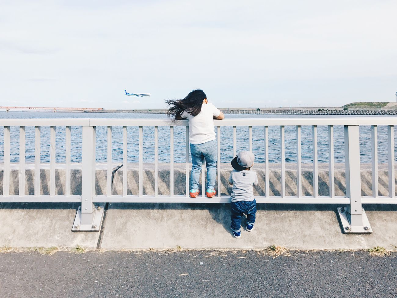 Hello My Baby Vscogood Vscocam VSCO Real People Leisure Activity Water Railing Outdoors Day Full Length Togetherness Sea Two People Lifestyles Rear View Motion Casual Clothing Women Standing Men Horizon Over Water Nature Sky Airplane