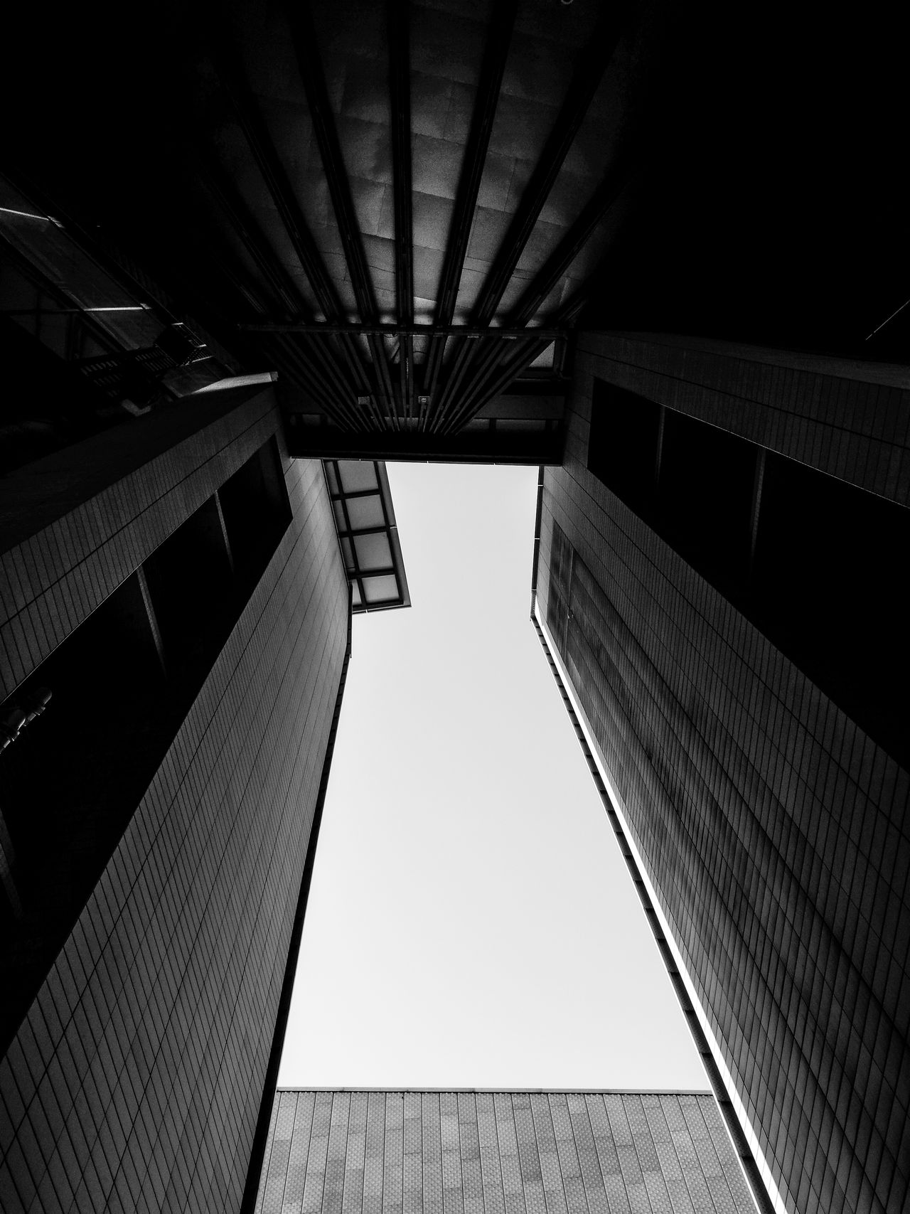 Monochromelookingup Architectural Detail Architectural Feature Architecture Architecture_bw Architecture_collection Architecturelovers Berlin Black & White Berlin Monochrome Berlin Schwarzweiss Black And White Berlin Building Exterior Built Structure City Huawei P9 Leica HuaweiP9 Huaweiphotography Low Angle View Modern Monochrome Monochrome Berlin Outdoors Sky