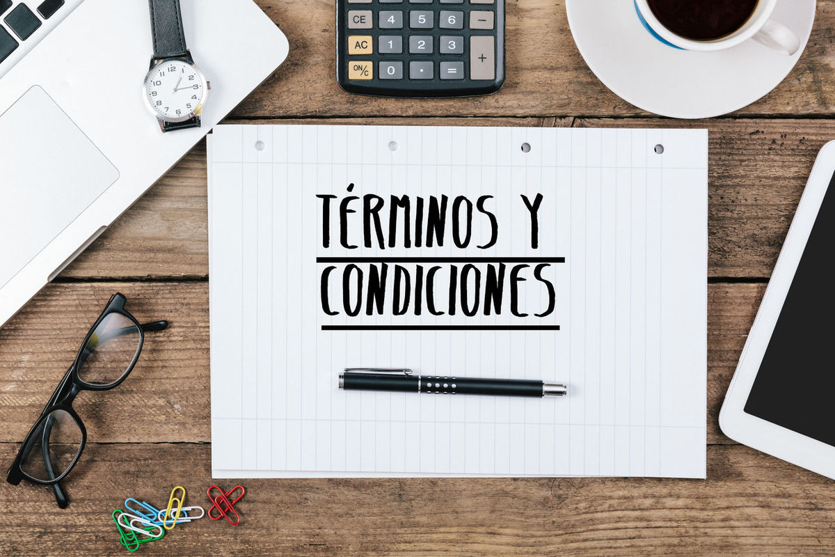 Terms and Conditions in Spanish Close-up Communication Computer Keyboard Conditions Day Desk Directly Above High Angle View Indoors  Language No People Paper Pen Pencil Portable Information Device Scissors Spanish Stapler Table Technology Terms Terms And Conditions Wireless Technology