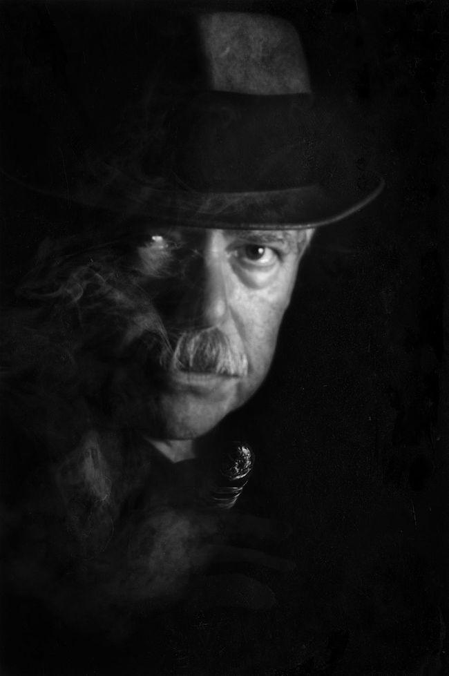 Film Noir of The Detective Black Background Black Color Close-up Dark Eyes, Fedora  Film Noir Hat Headshot Human Face Leisure Activity Lifestyles Moustash Portrait Staring The Detective  The Detective, Tough