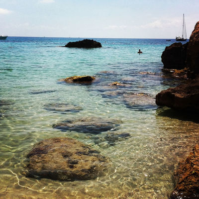 Swimming at Cala Tarida by Pablo