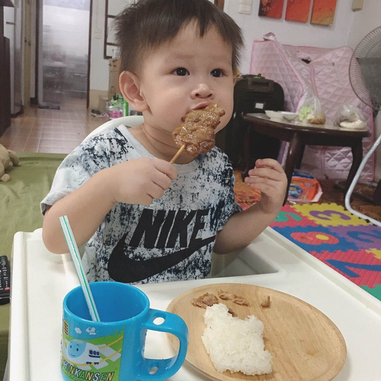 real people, food and drink, indoors, food, childhood, table, one person, cake, eating, home interior, cute, plate, lifestyles, looking at camera, sweet food, day, portrait, boys, freshness, ice cream, close-up