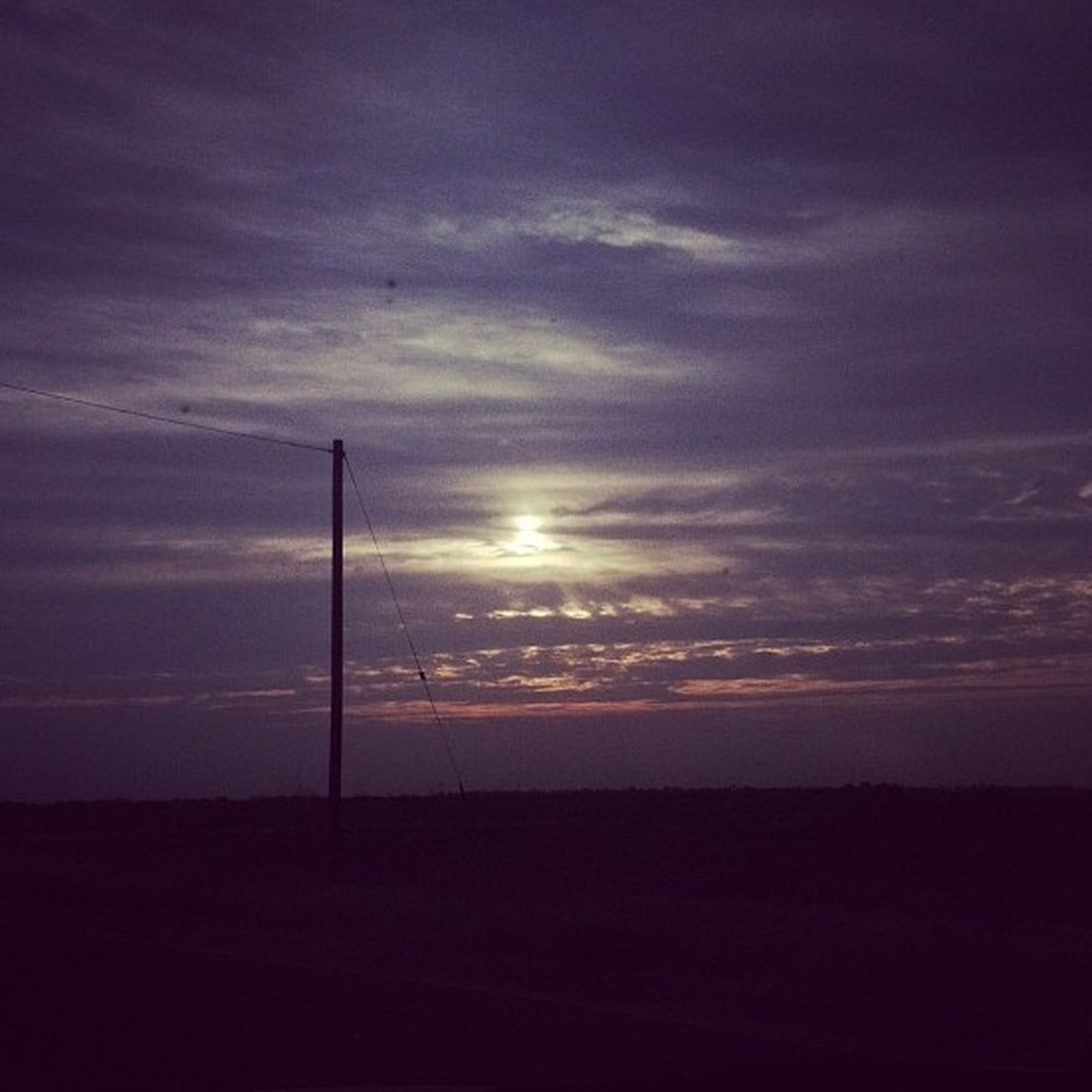 sunset, silhouette, sky, tranquility, scenics, tranquil scene, landscape, beauty in nature, sun, cloud - sky, nature, orange color, field, idyllic, cloud, outdoors, dark, horizon over land, cloudy, dusk