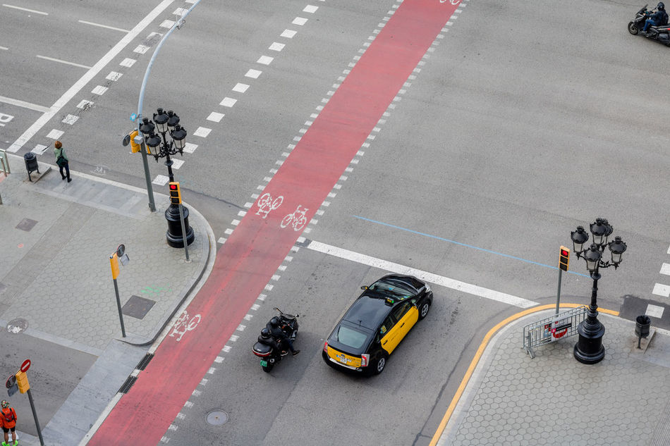 Road Transportation High Angle View Car Full Length Sports Race Sports Track People Adults Only Land Vehicle Outdoors Women Running Track Men Real People Only Men Day Adult Starting Line Track And Field SPAIN Barcelona City Street Lifestyles Portrait Of A City