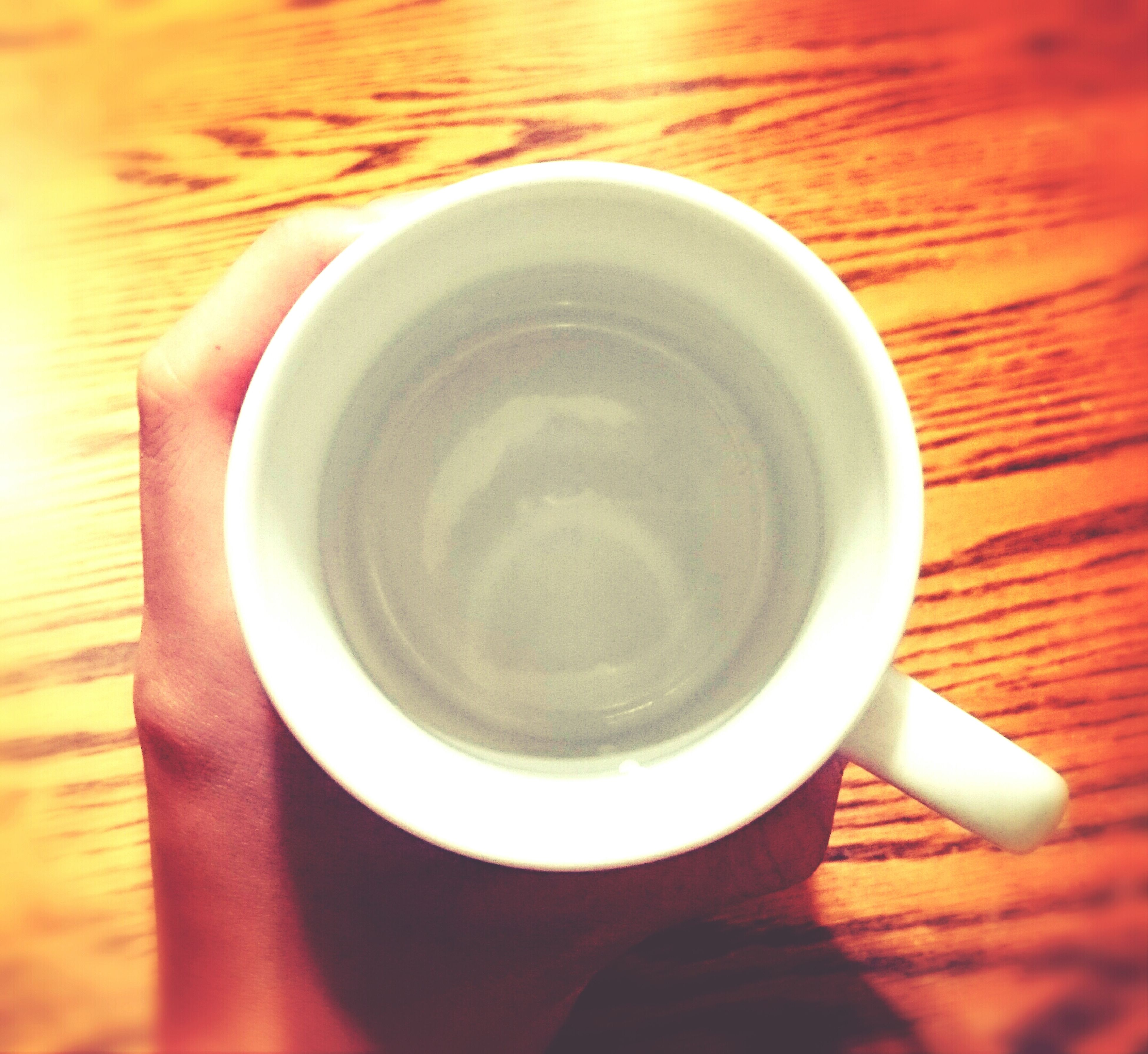 drink, coffee cup, food and drink, indoors, refreshment, coffee - drink, table, coffee, freshness, saucer, cup, spoon, still life, tea cup, high angle view, beverage, close-up, directly above, hot drink, tea