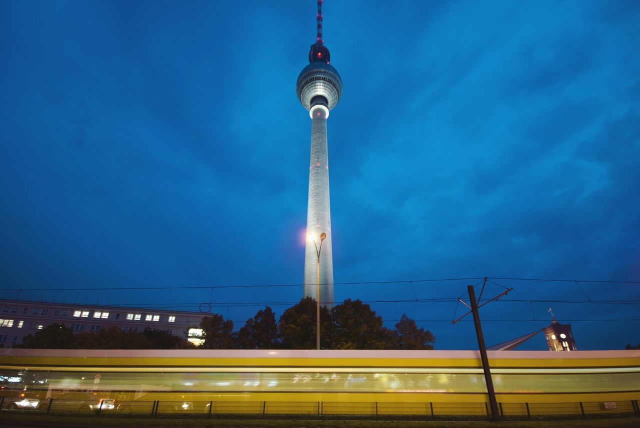 Low Angle View Of Moving Train And Fernsehturm At Night