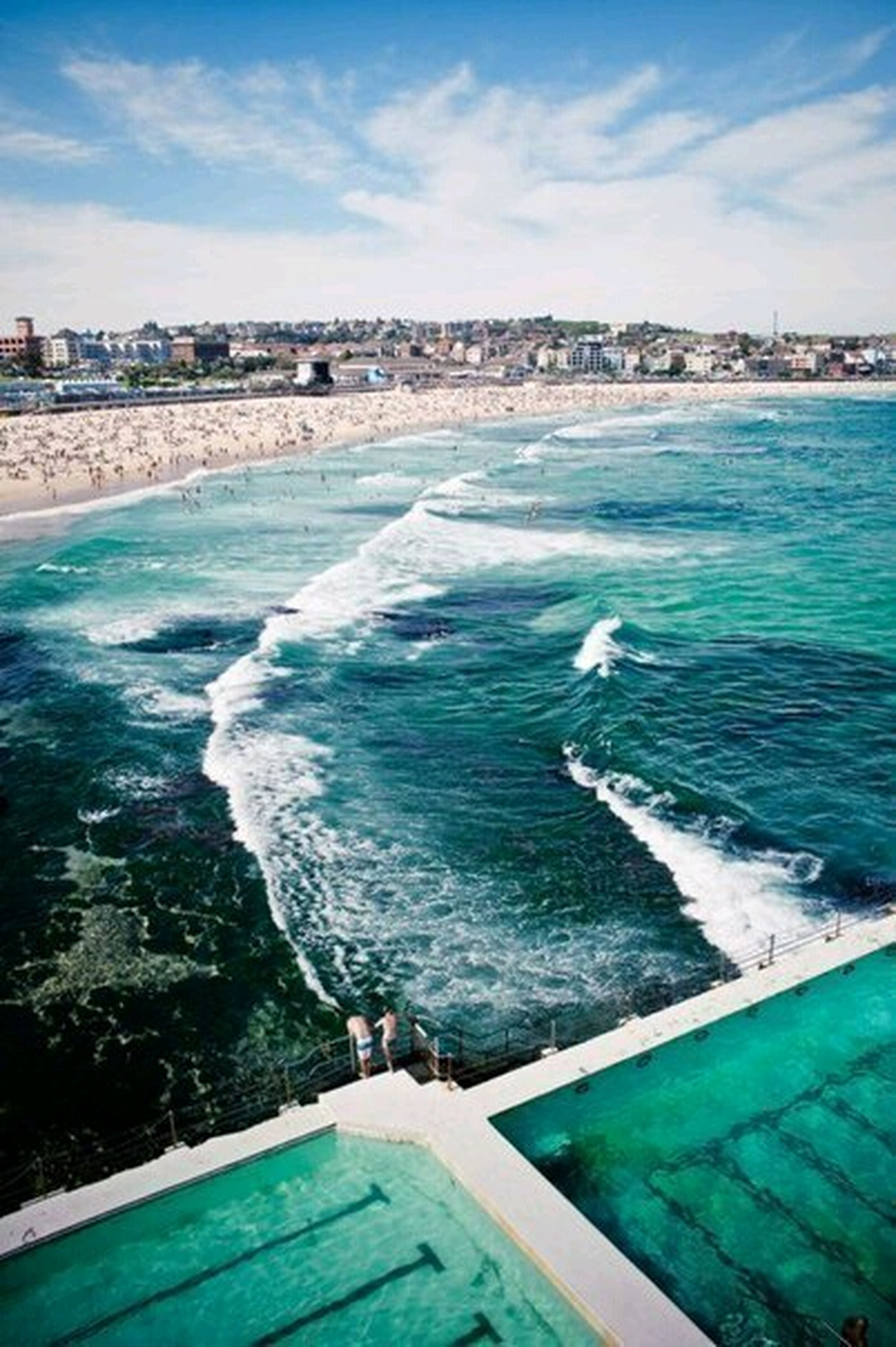 water, sea, blue, building exterior, built structure, architecture, sky, wave, surf, beach, city, swimming pool, shore, turquoise colored, horizon over water, coastline, high angle view, cloud - sky, nature, scenics