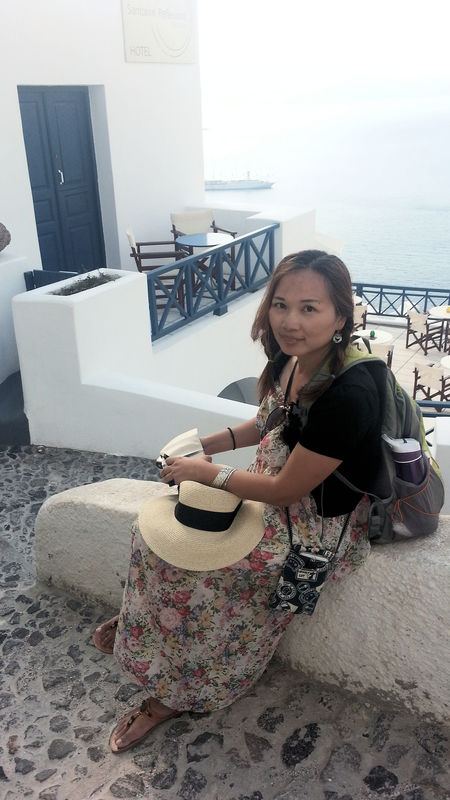 One Woman Only Only Women Santorini, Greece Sitting Outside White And Blue Colour Young Woman Smiling