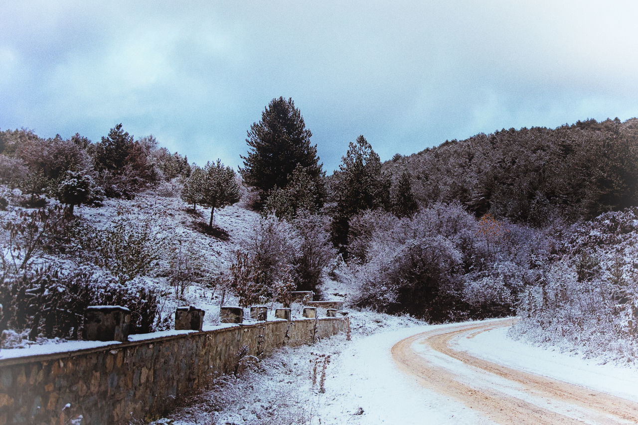 Winter in Bolu Beauty In Nature Cold Temperature Day Dirt Road Hills And Valleys Hillside Icy Nature No People Outdoors Paths Pathway Sky Sky And Clouds Snow Snowy Mountains Tree Trees And Sky Water Winding Path Winding Road Winter Trees Wintertime