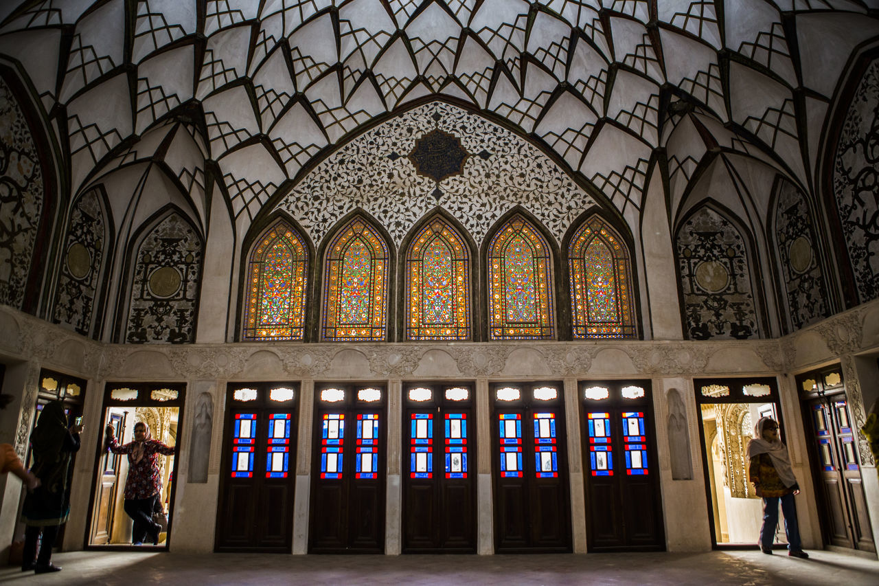 Tanatabai House is one of most beautiful house in Kashan city, in one of main Rooms i took this picture with people who taking Selfies and walking into this room i love architect in Kashan, in 1834 this house was made by Seyed Jafar Tabatabai, he was Rug merchant and he was so rich person at Qajar age. Arch Architecture Clothes Dress Indoors  Iran Iranian Iranian People Kashan People Qajar Dress Tabatabai The Architect - 2017 EyeEm Awards The Great Outdoors - 2017 EyeEm Awards The Photojournalist - 2017 EyeEm Awards The Portraitist - 2017 EyeEm Awards Traditional Clothing Traditional Costume Travel Destinations Window BYOPaper! Live For The Story