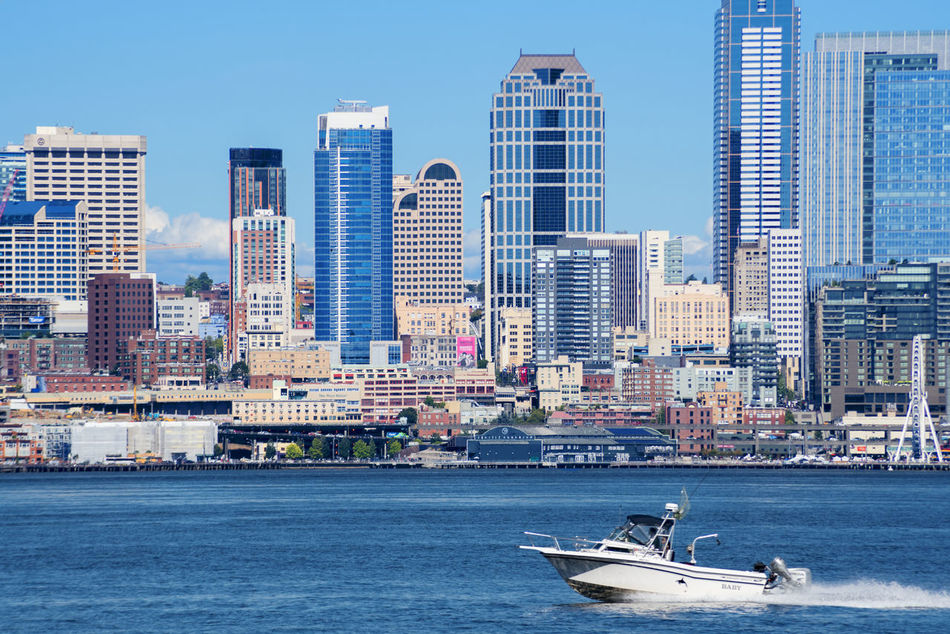 Sunny day over Elliott Bay Seattle Washington, skyline with boat. Architecture Blue Blue Sky Boating Building Exterior Built Structure City Cityscape Day Modern Nautical Vessel No People Outdoor Recreation Outdoors Sea Seattle Sky Skyline Skyscraper Transportation Urban Skyline Water Waterfront