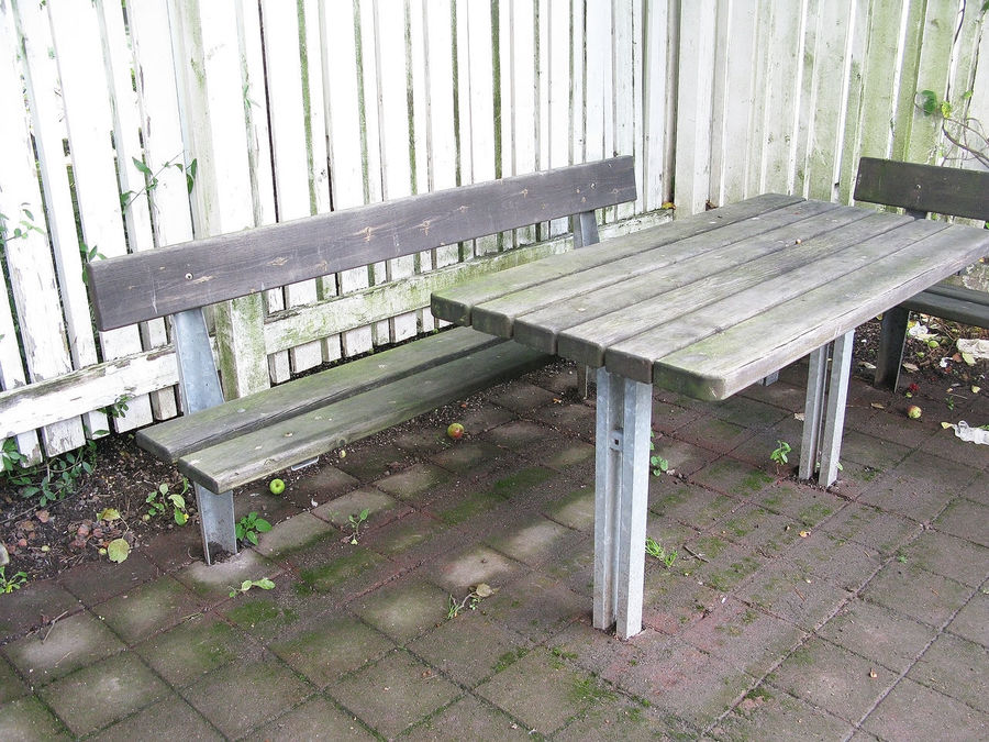 Mossy and depressing bench and table area outside a residential building in need of renovation in Stockholm, Sweden. Renovation Day Empty Flakes Nature No People Outdoors Table Trashyart Wood - Material
