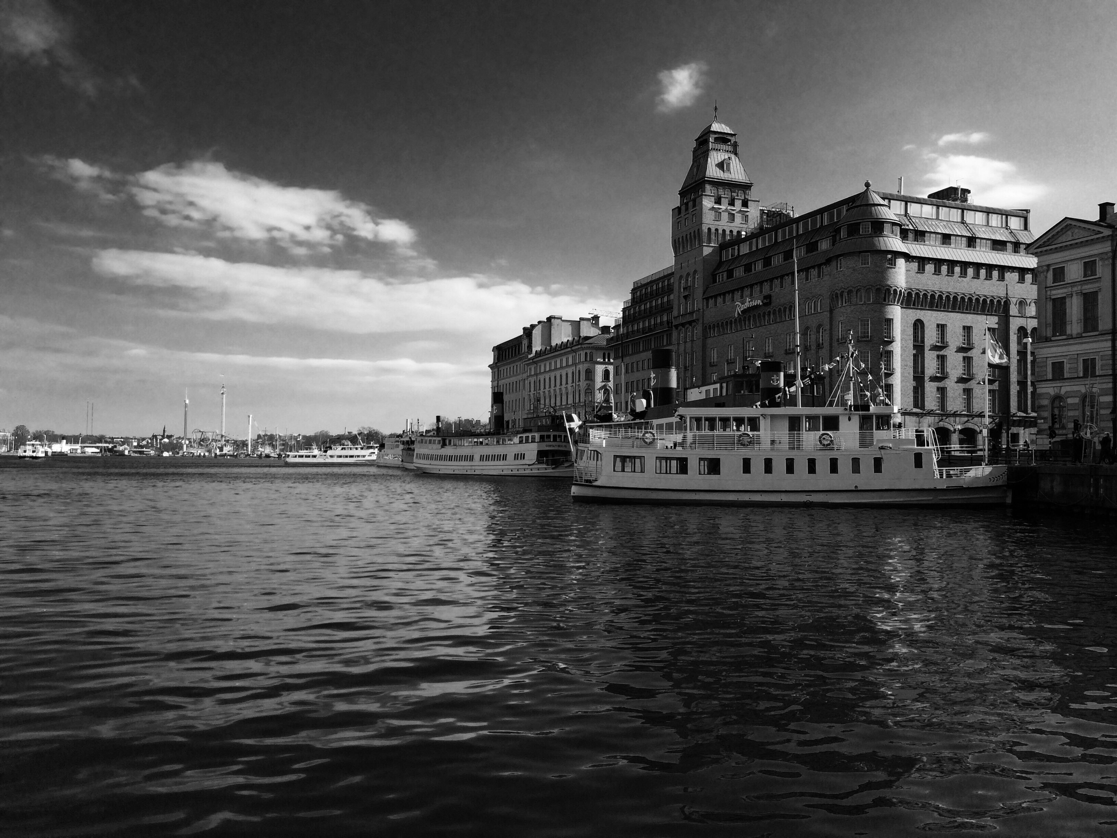building exterior, architecture, built structure, water, waterfront, sky, nautical vessel, transportation, city, rippled, mode of transport, river, cloud - sky, boat, travel, travel destinations, cloud, canal, outdoors, building
