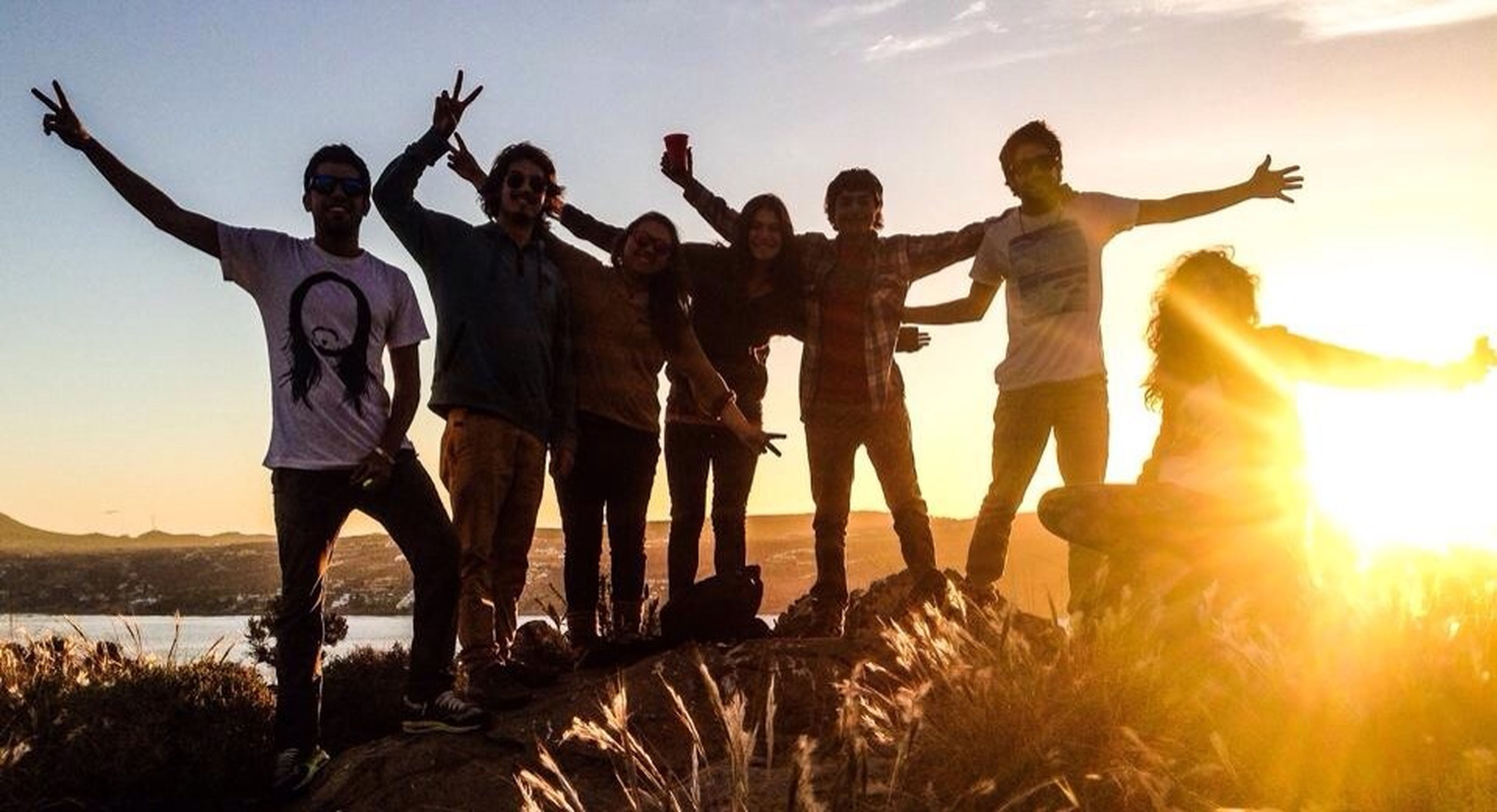 sun, sunset, togetherness, sunlight, lifestyles, men, sunbeam, leisure activity, sky, standing, lens flare, person, horse, full length, friendship, nature, outdoors, silhouette, vacations