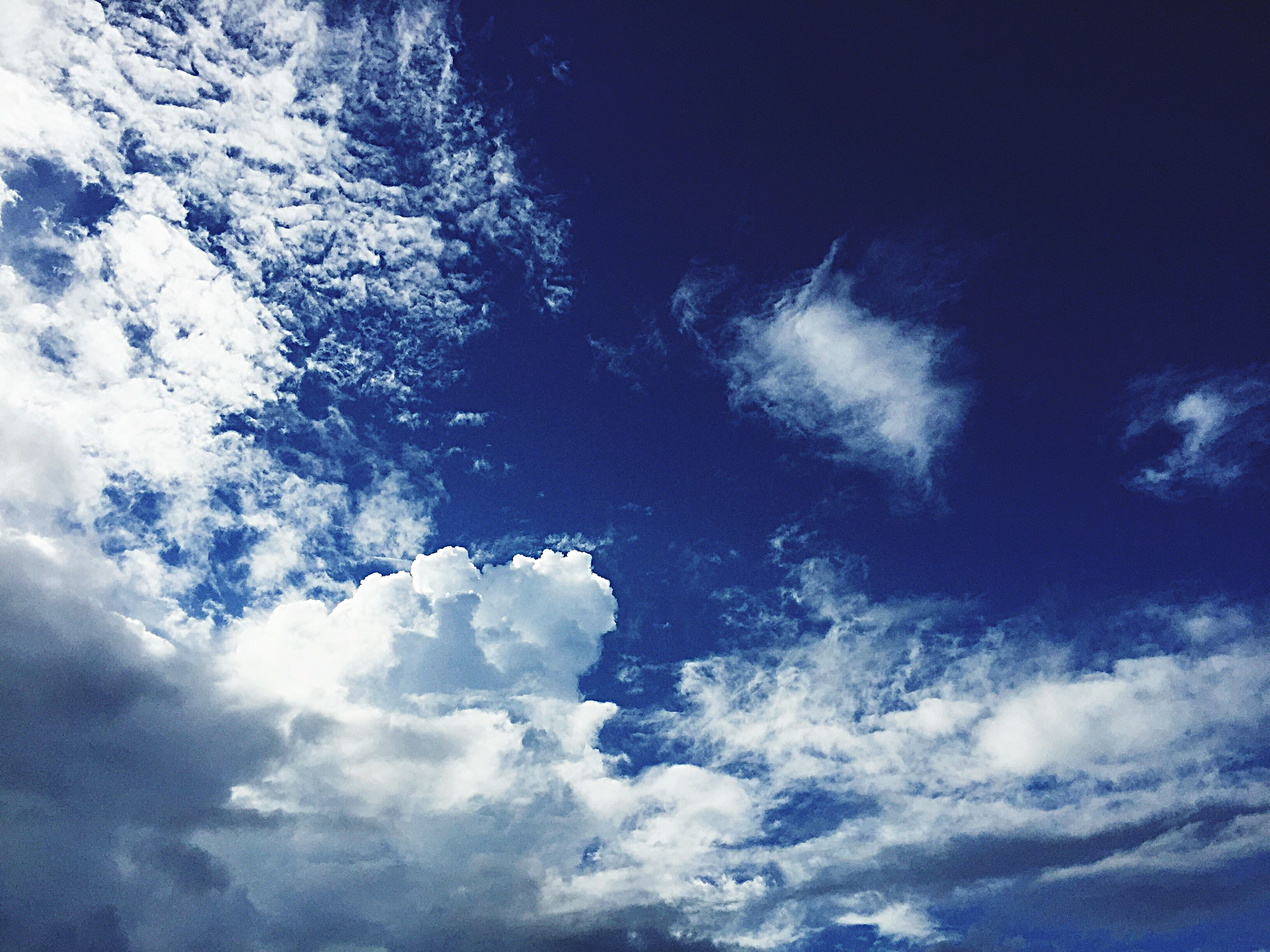 low angle view, sky, tranquility, beauty in nature, cloud - sky, sky only, scenics, nature, tranquil scene, backgrounds, blue, full frame, idyllic, cloudy, cloudscape, outdoors, majestic, no people, cloud, weather, day, white