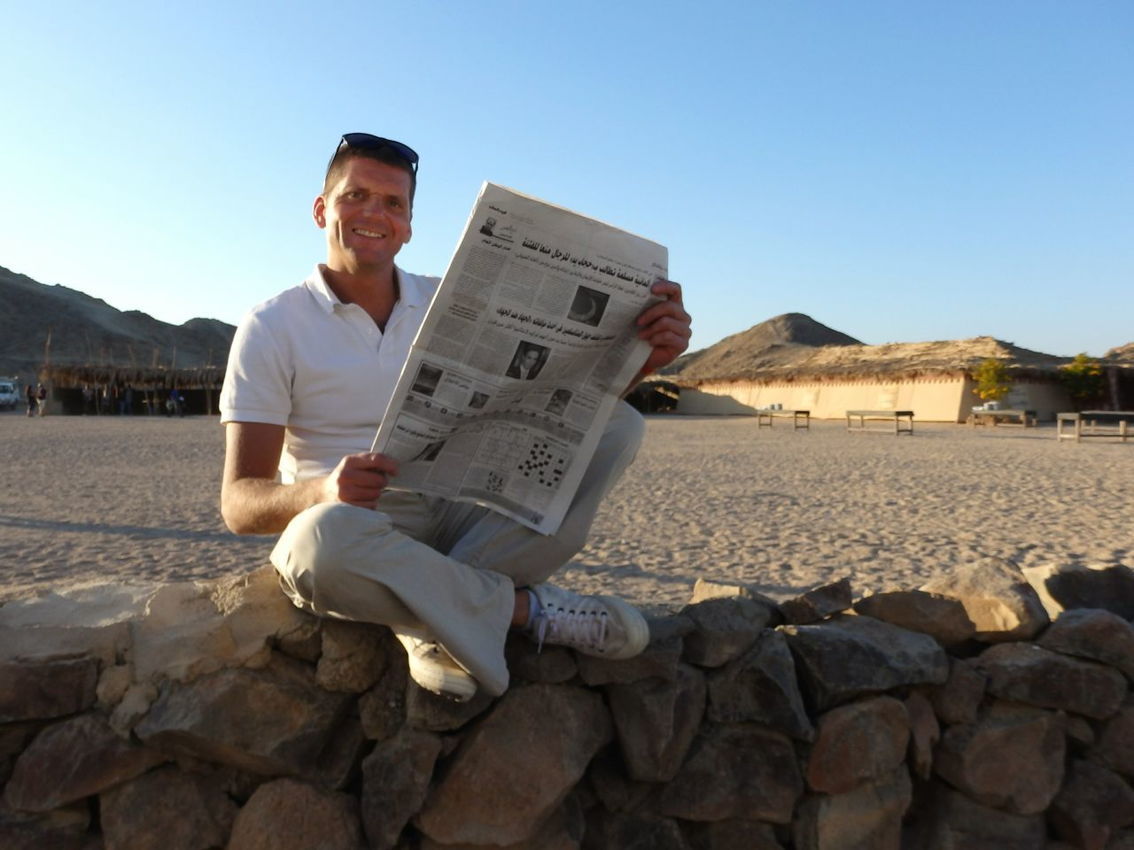 Beautiful stock photos of newspaper, 40-44 Years, Beach, Built Structure, Casual Clothing