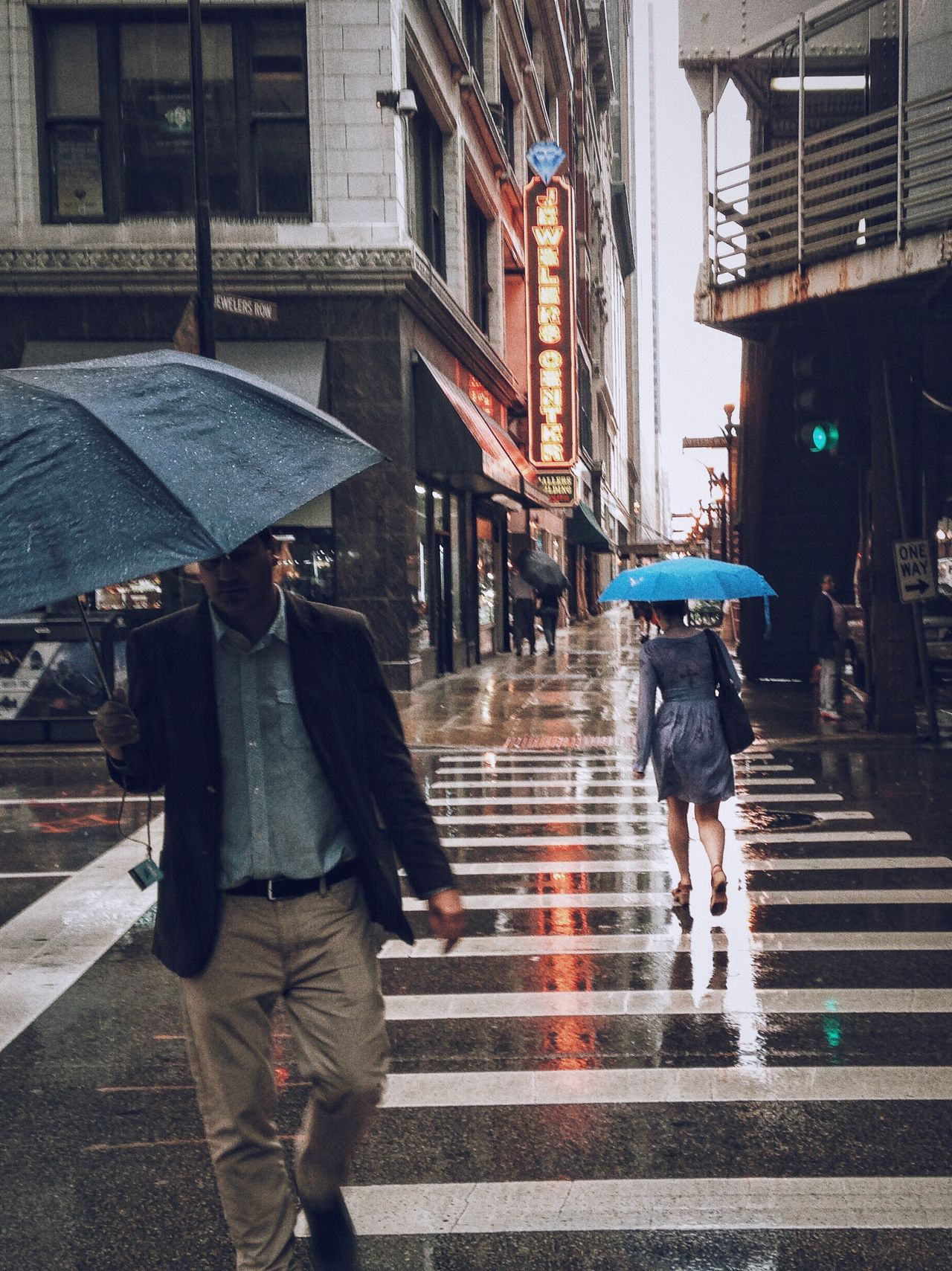 City Street Walking Rain Wet Building Exterior Built Structure Pedestrian City Life Outdoors Architecture Urgency Full Length People Adults Only One Person Adult Night