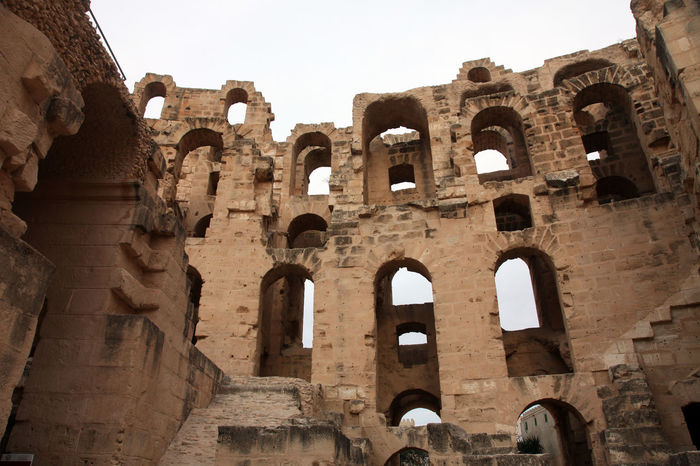 The amphitheater in El Jem, Tunisia Built Structure Abandoned Africa Amphitheater Ancient Arches Arena Arhitecture Building Exterior El Jem Empire Erosion Famous Place Famous Place Gladiator Heritage History Landmark Old Ruin Roman Ruined Stone Stone Tunisia Unesco
