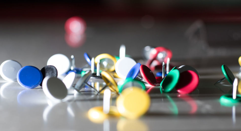These are assortments studio shots of thumb tacks. Abstract Abstract Photography ArtWork Assortment Blue Copy Space Dof EyeEm Gallery Green Howard Roberts Light And Shadow Minimalism No People Pattern Patterns & Textures Relaxing Sharp Studio Studio Photography Studio Shot This Week On Eyeem Thumb Tack Collection Thumb Tacks Thumbtack White