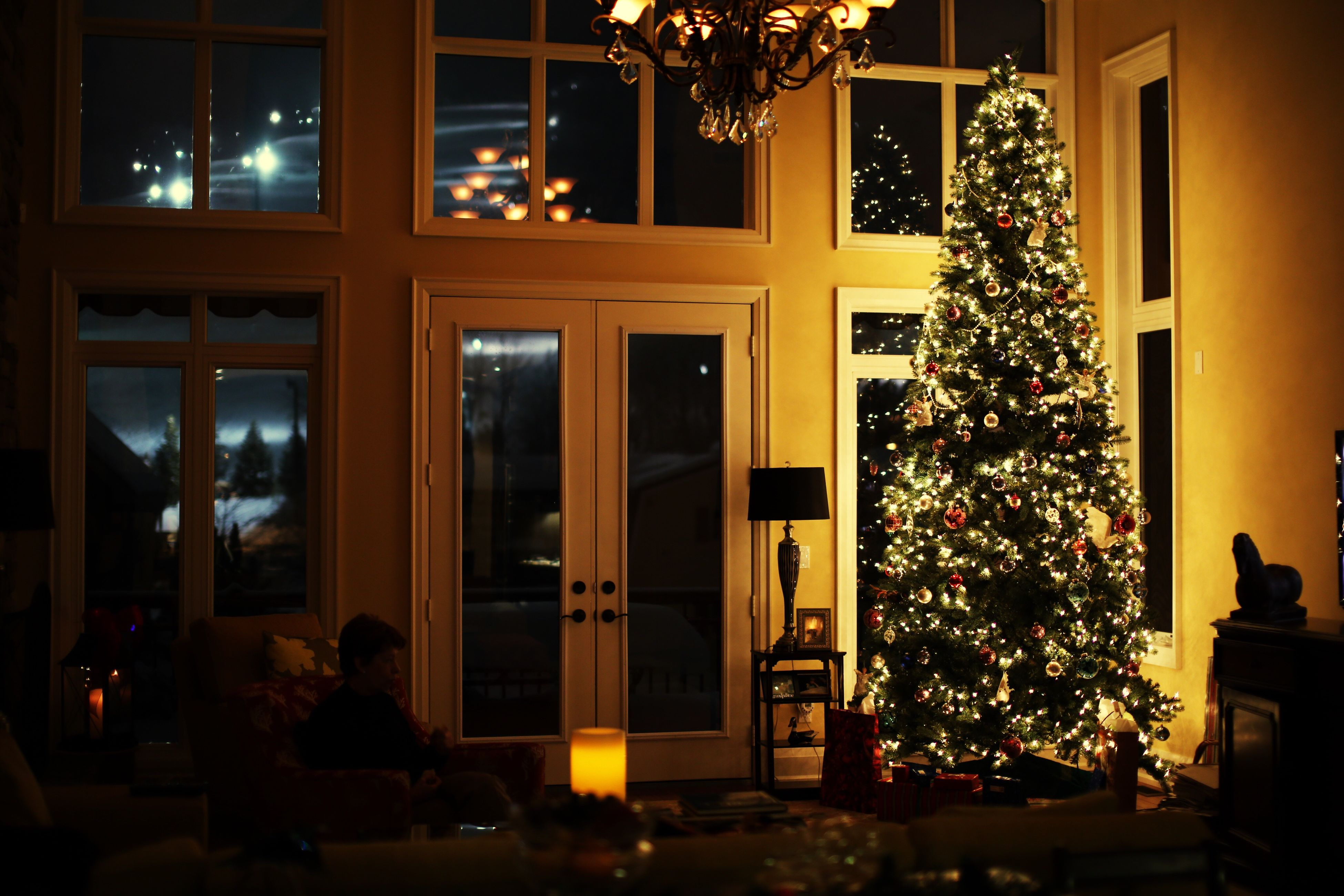 window, indoors, illuminated, glass - material, architecture, night, built structure, decoration, lighting equipment, home interior, building exterior, christmas, transparent, celebration, house, christmas decoration, christmas tree, curtain, dark, table