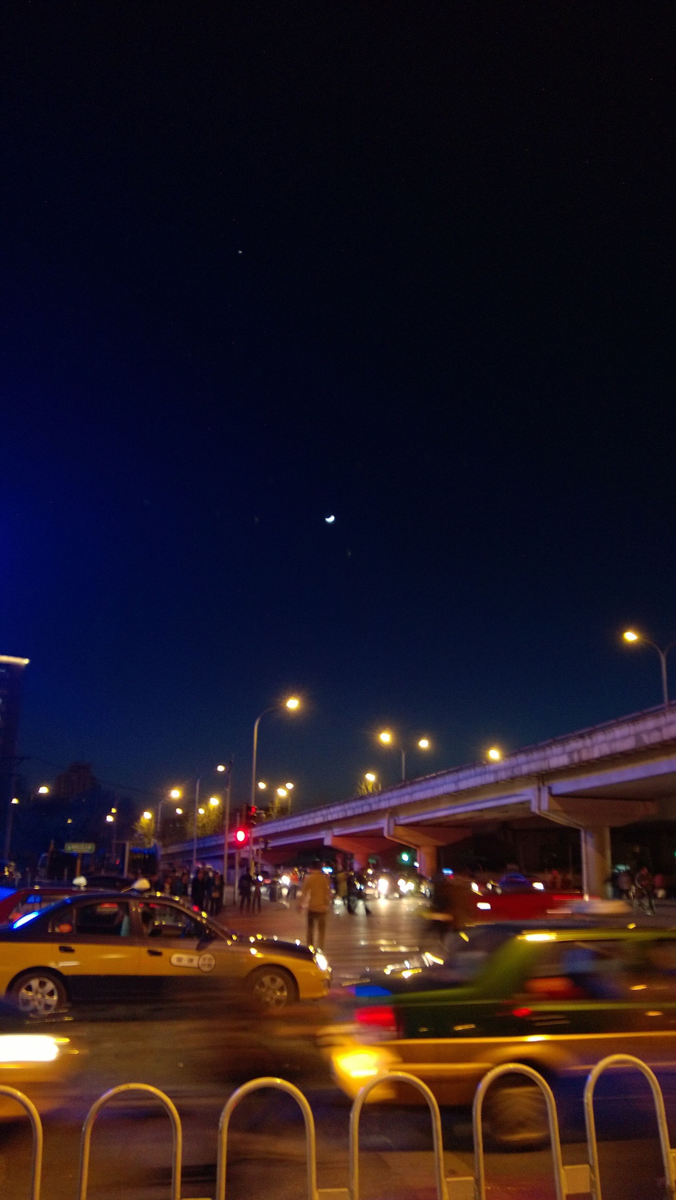 illuminated, transportation, night, car, mode of transport, land vehicle, street light, street, clear sky, road, city, traffic, building exterior, copy space, built structure, architecture, lighting equipment, headlight, on the move, city street