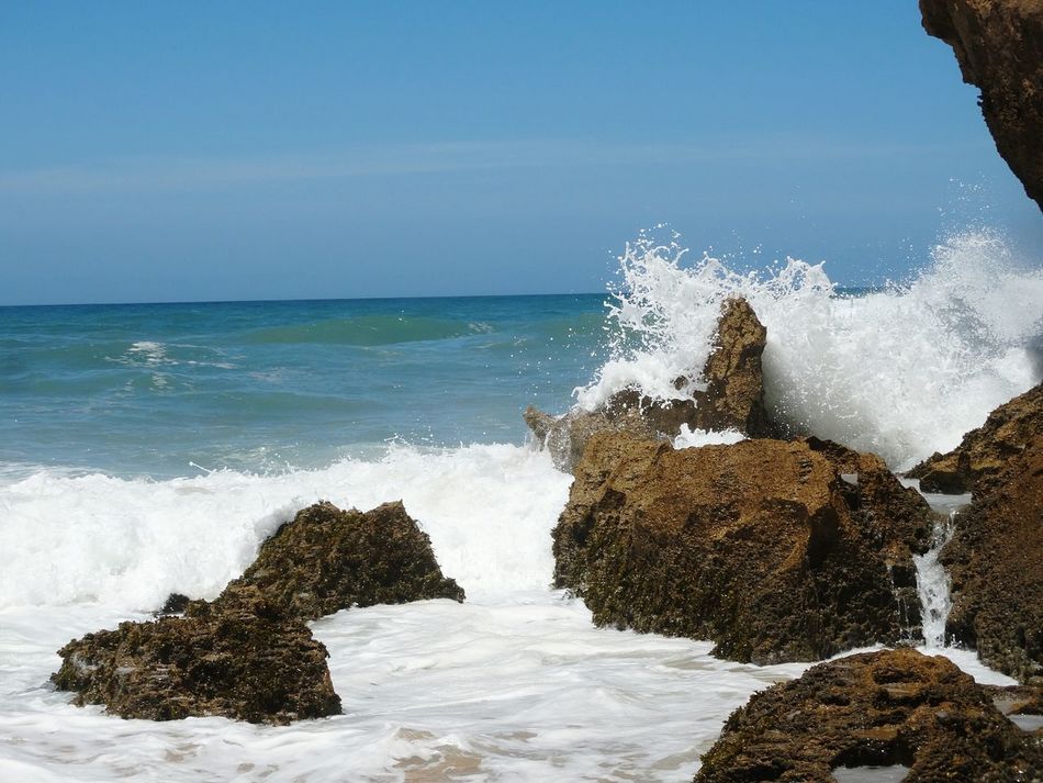 Wave and rocks. Shore Morocco Oualidia Oualidia Beach Africa Fine Art Photography Waves Wave Crash Rock Ocean Beach Nature Summer Blue Wave Wave Splash Wave And Beach Nature Photography Wave Waves & Rocks Foam Beach Day Sunshine Water Eyem GalleryColorful