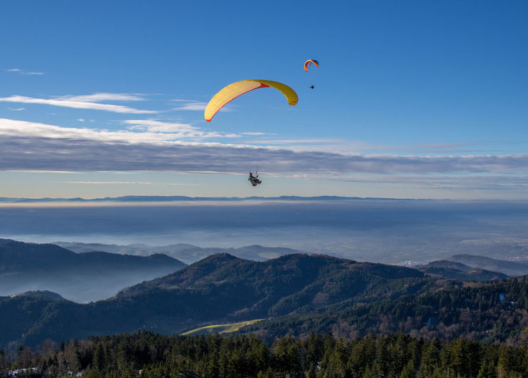 Adult Adventure Beauty In Nature Cloud - Sky Fly Flying Flying High Landscape Leisure Activity Mountain Nature One Person Outdoors Parachute Paragliding People Scenics Sky Schwarzwald Blackforest Rheintal  Vogesen