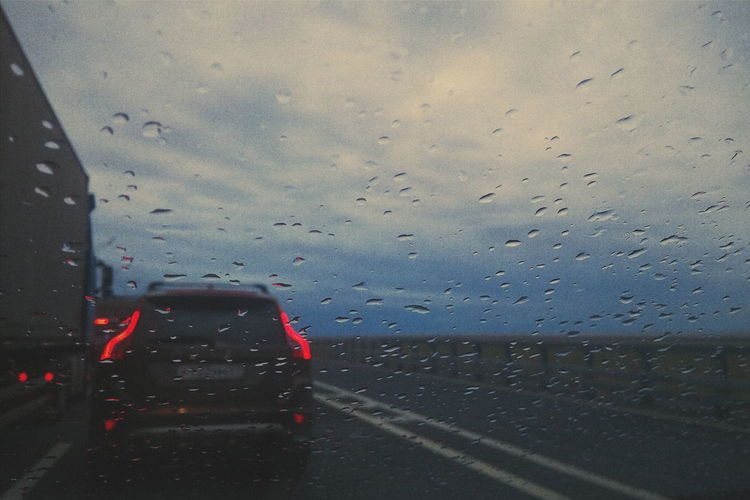 Road No People Window Rain Transportation Travel Water Aqua RainDrop One The Road One The Way Car Light Dark Darkness And Light Dark Photography Drops Weather Focus On Foreground EyeEm Best Shots EyeEm Gallery Eyemphotography