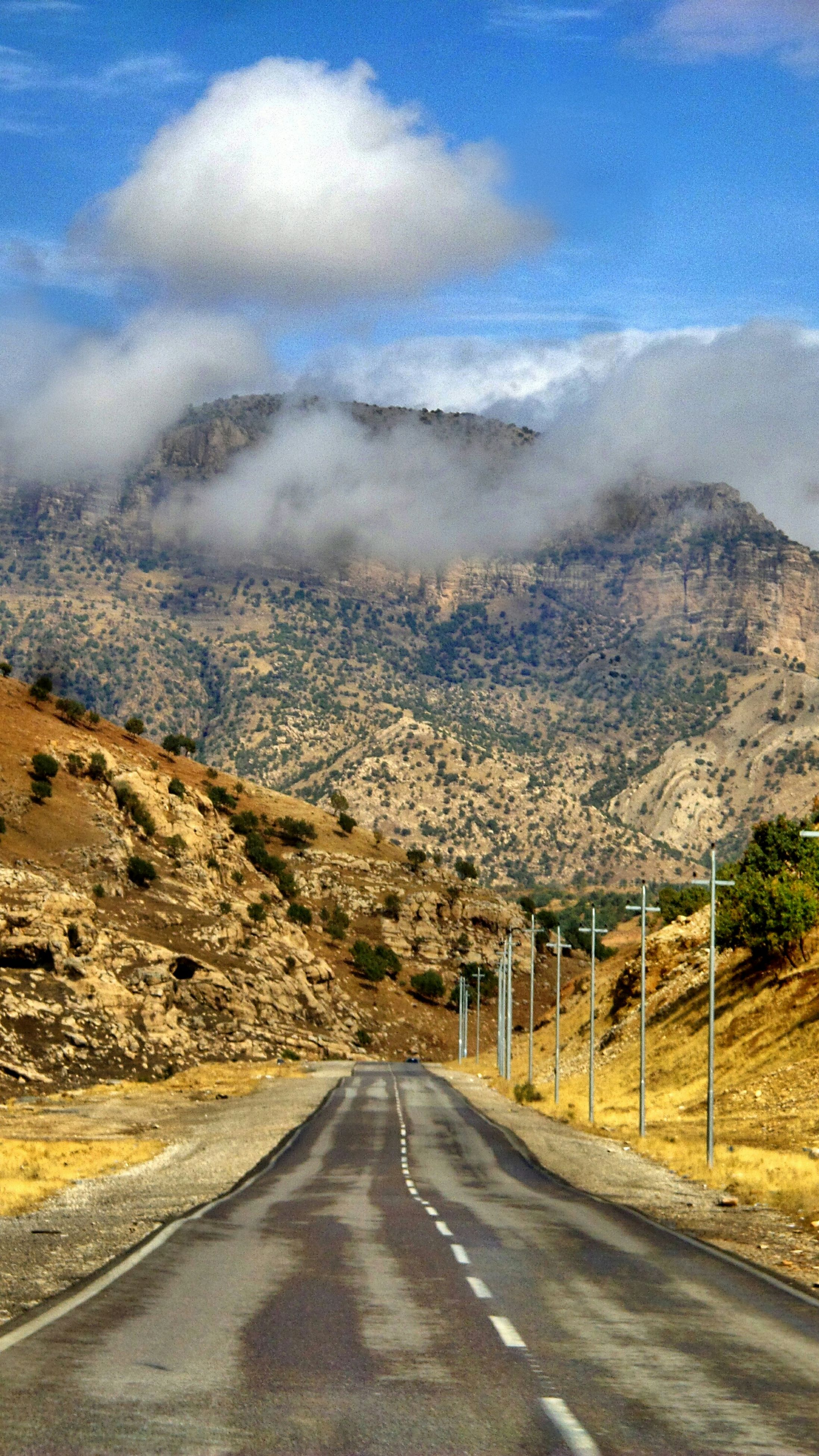 the way forward, road, sky, transportation, mountain, diminishing perspective, country road, vanishing point, landscape, cloud - sky, road marking, empty road, tranquil scene, nature, scenics, tranquility, cloud, beauty in nature, street, mountain range