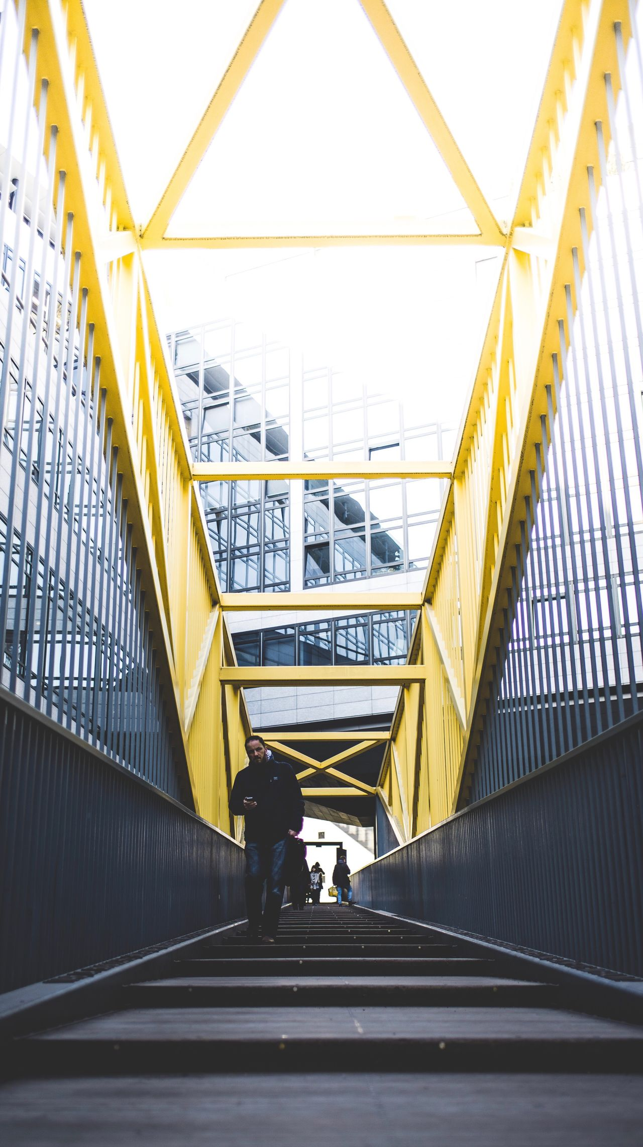 Full Length Real People Architecture Railing Two People Built Structure Yellow Steps And Staircases Lifestyles Men Staircase Day Bridge - Man Made Structure Outdoors Only Men Adults Only People Adult