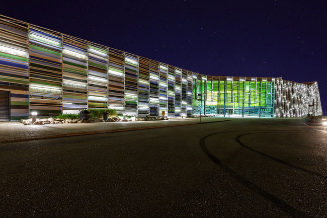 KOTKA, FINLAND - SEPTEMBER 03, 2016: View of the Maritime centre Vellamo at night Architecture Building Exterior Built Structure Empty Road Exterior Illuminated Modern Night No People Office Building Outdoors Road Sky Street Surface Level The Way Forward
