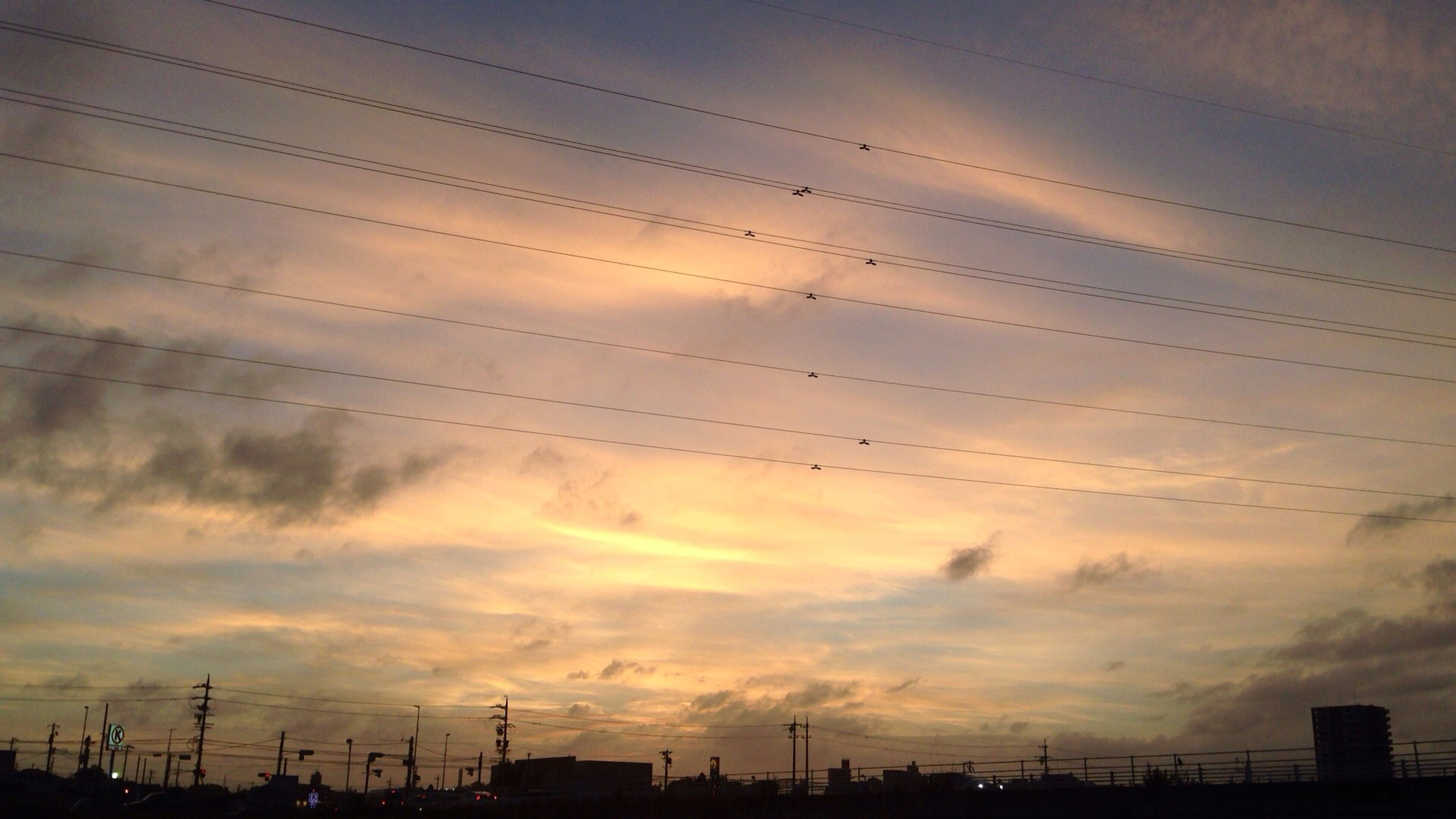 silhouette, sunset, power line, sky, electricity pylon, low angle view, connection, cloud - sky, electricity, power supply, fuel and power generation, cable, cloud, nature, dusk, cloudy, beauty in nature, technology, scenics, tranquility