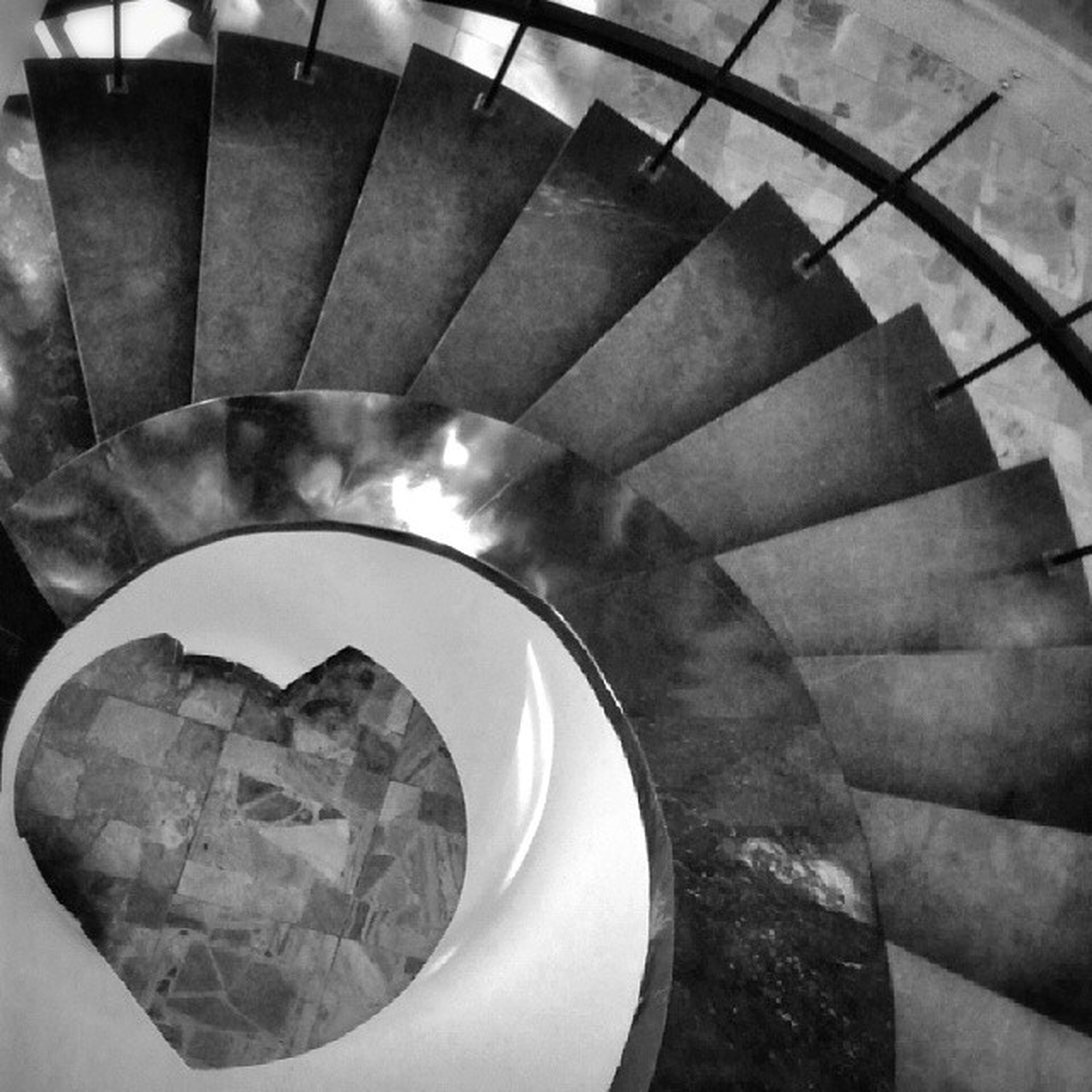 indoors, architecture, steps and staircases, built structure, steps, spiral staircase, staircase, ceiling, railing, spiral, circle, high angle view, geometric shape, pattern, low angle view, modern, building, no people, illuminated, arch