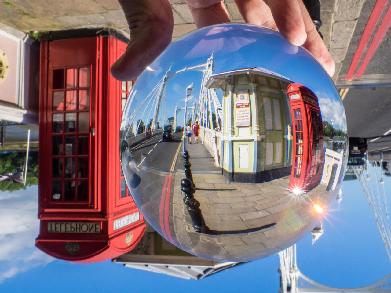 My favourite bridge over the Thames, seen through a crystal ball. Albert Bridge Architecture Architecture Bridge Britain Capital Copy Space Crystal Ball Day England Famous Place Human Hand London No People Outdoors Suspension Bridge Telephone Booth Tourism Transportation United Kingdom