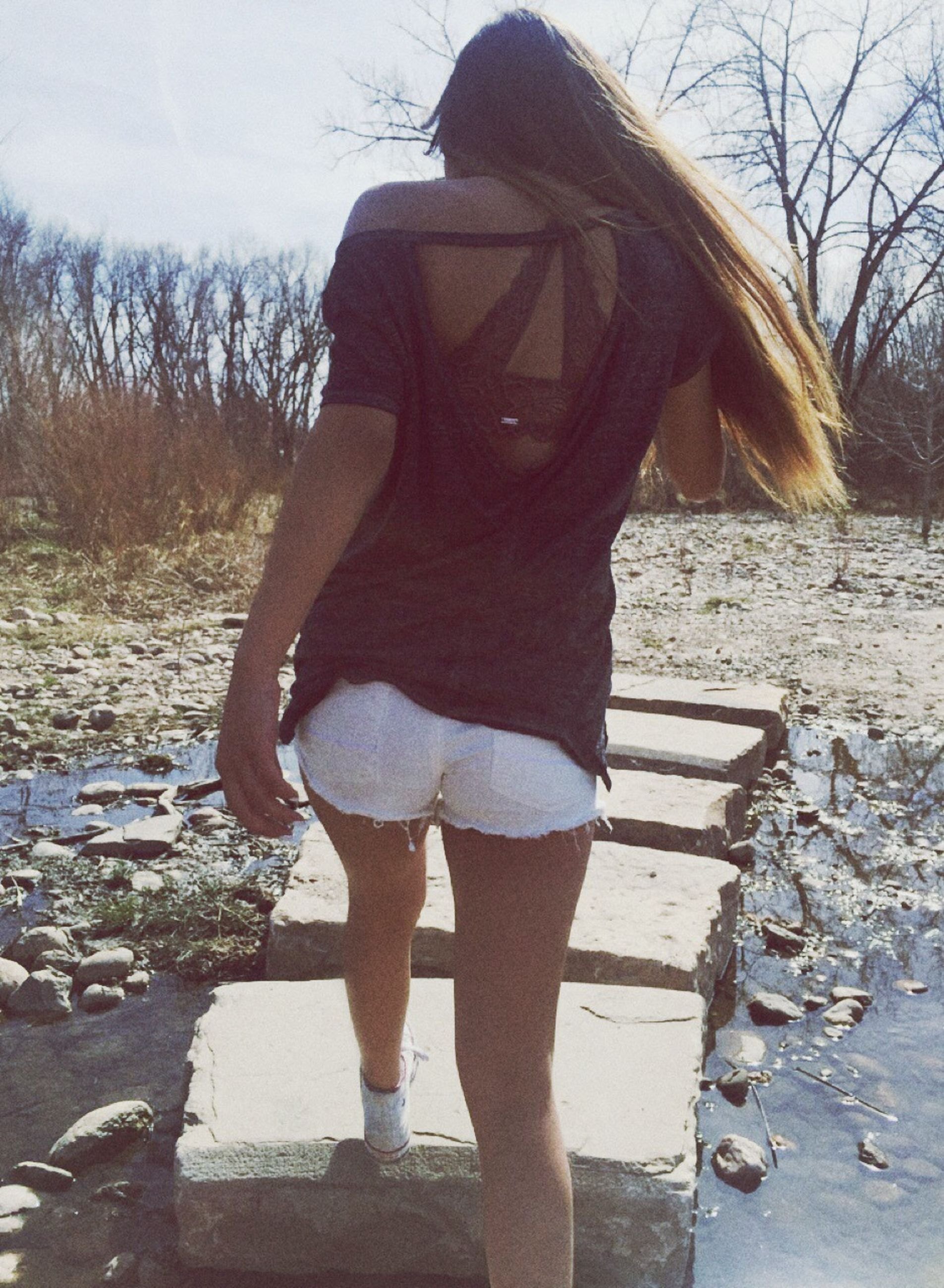 lifestyles, standing, leisure activity, bare tree, young adult, casual clothing, tree, full length, young women, person, rear view, three quarter length, outdoors, day, long hair, side view, front view, water