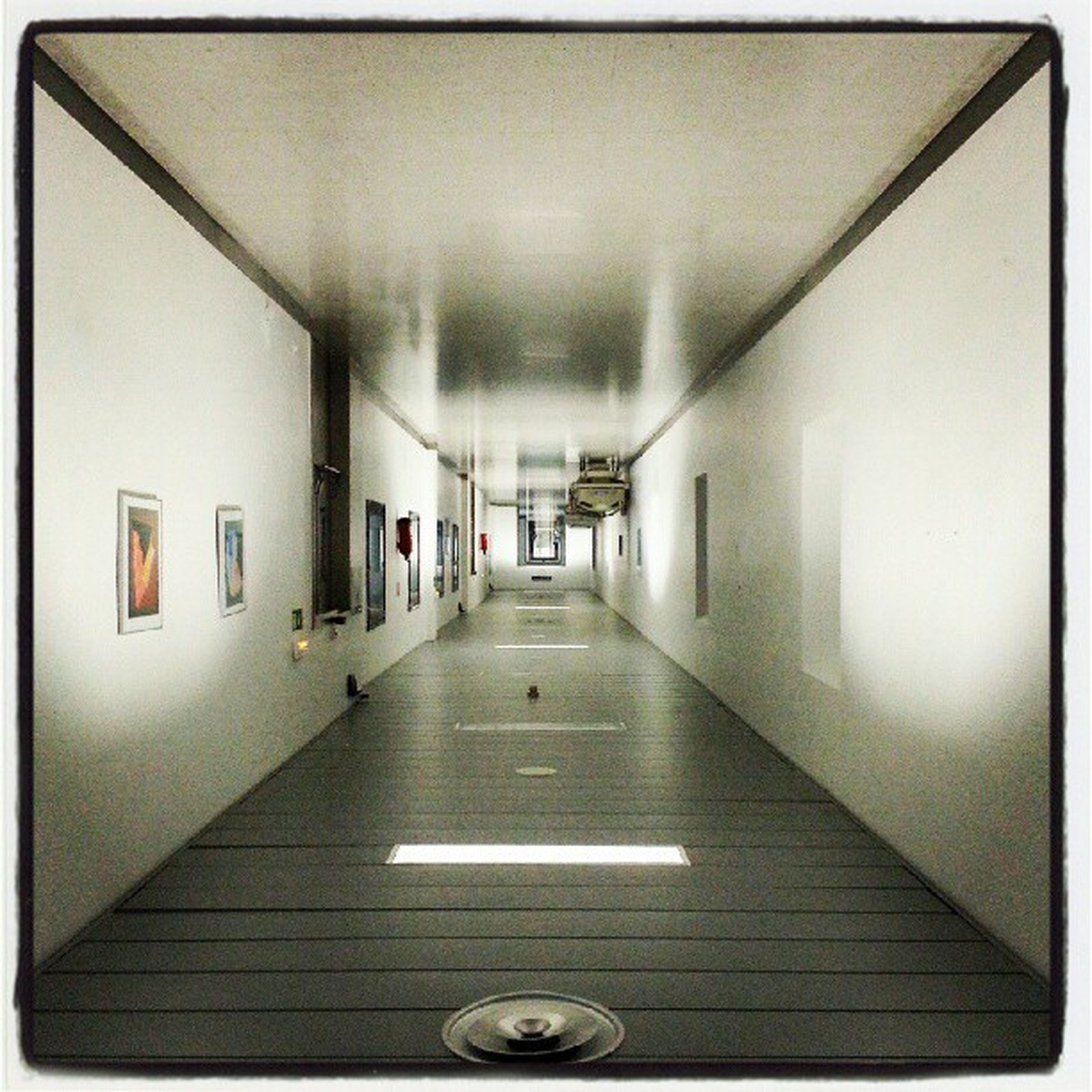 indoors, corridor, illuminated, ceiling, the way forward, architecture, built structure, lighting equipment, empty, diminishing perspective, absence, flooring, wall - building feature, door, building, tiled floor, interior, auto post production filter, subway, transfer print