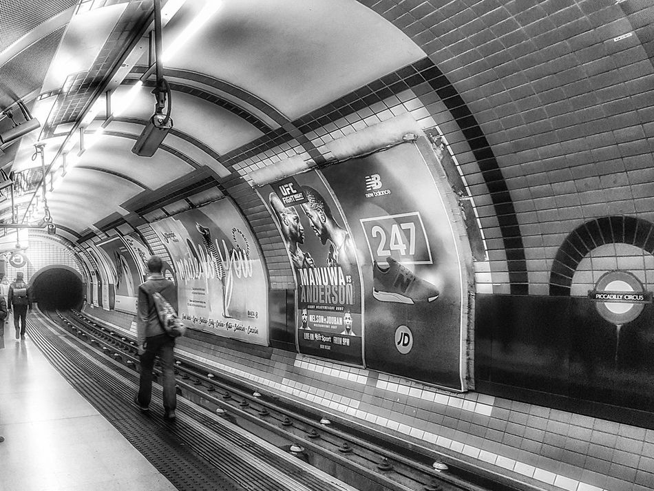 Piccadilly Circus Tube Station - 23 April 2017 - London, England Transportation Public Transportation Rail Transportation Train - Vehicle Railroad Station Subway Train Arch Indoors  Mode Of Transport Railroad Track Illuminated Real People Commuter Commuter Train Day People Samsung Galaxy S7 Spring2017 Spring 2017 Tube Station  Piccadillycircus Piccadillystation Piccadilly Underground Underground Station