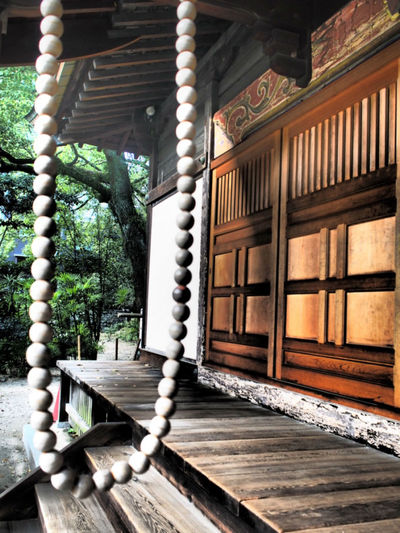 Traditional beads in a Japanese Temple, Fukuoka Beads Buddha City Fukuoka,Japan Fukuoka-shi Japan Japan Photography Japanese Garden Architecture Buddha Beads Buddhism Fukuoka Japan Culture Japanese Architecture No People Outdoors Staircase Steps Travel Destination Travel Destinations Wood - Material