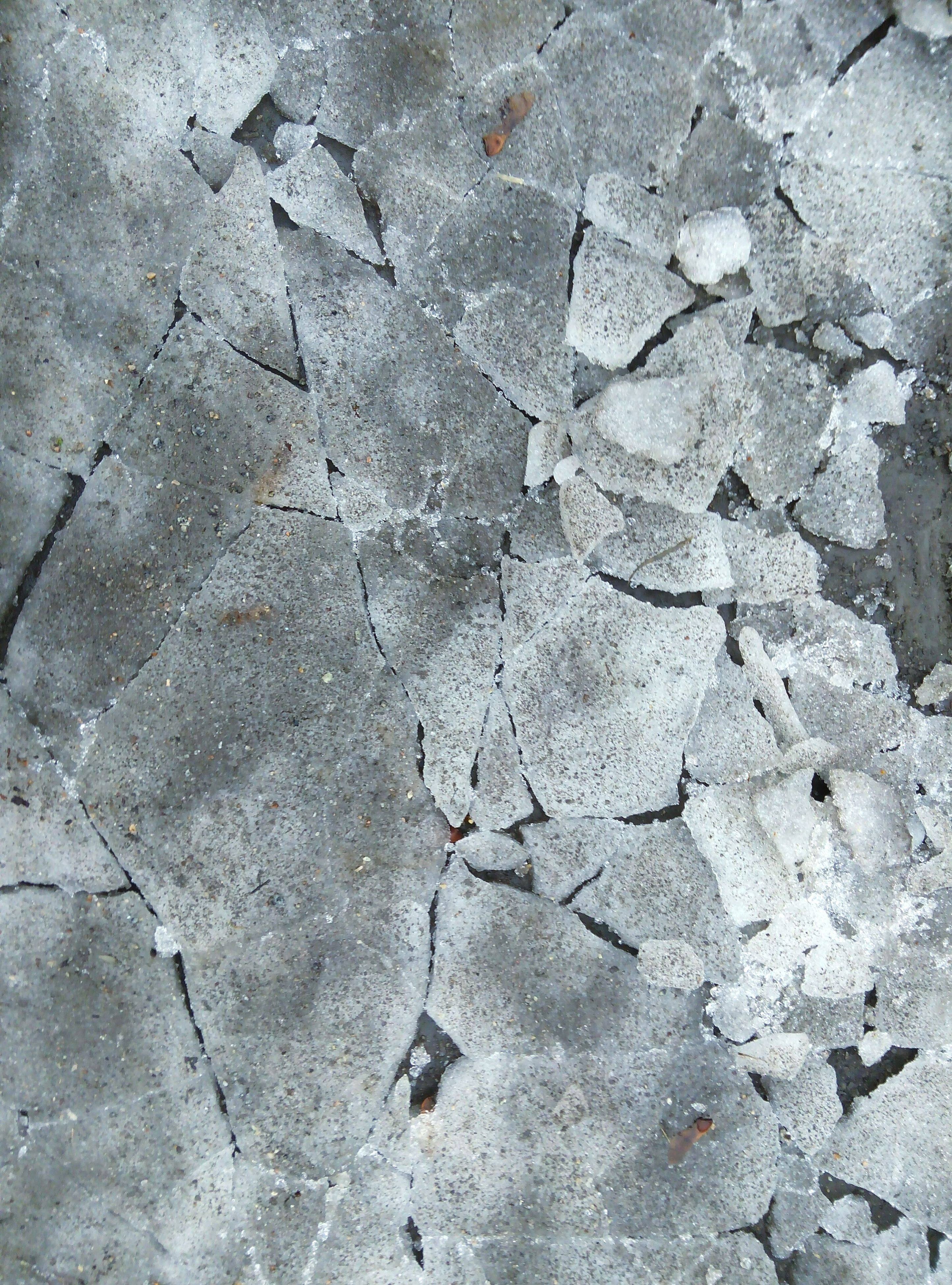 textured, full frame, backgrounds, high angle view, rough, wall - building feature, cracked, pattern, street, close-up, outdoors, day, no people, weathered, built structure, damaged, wall, asphalt, concrete, stone - object